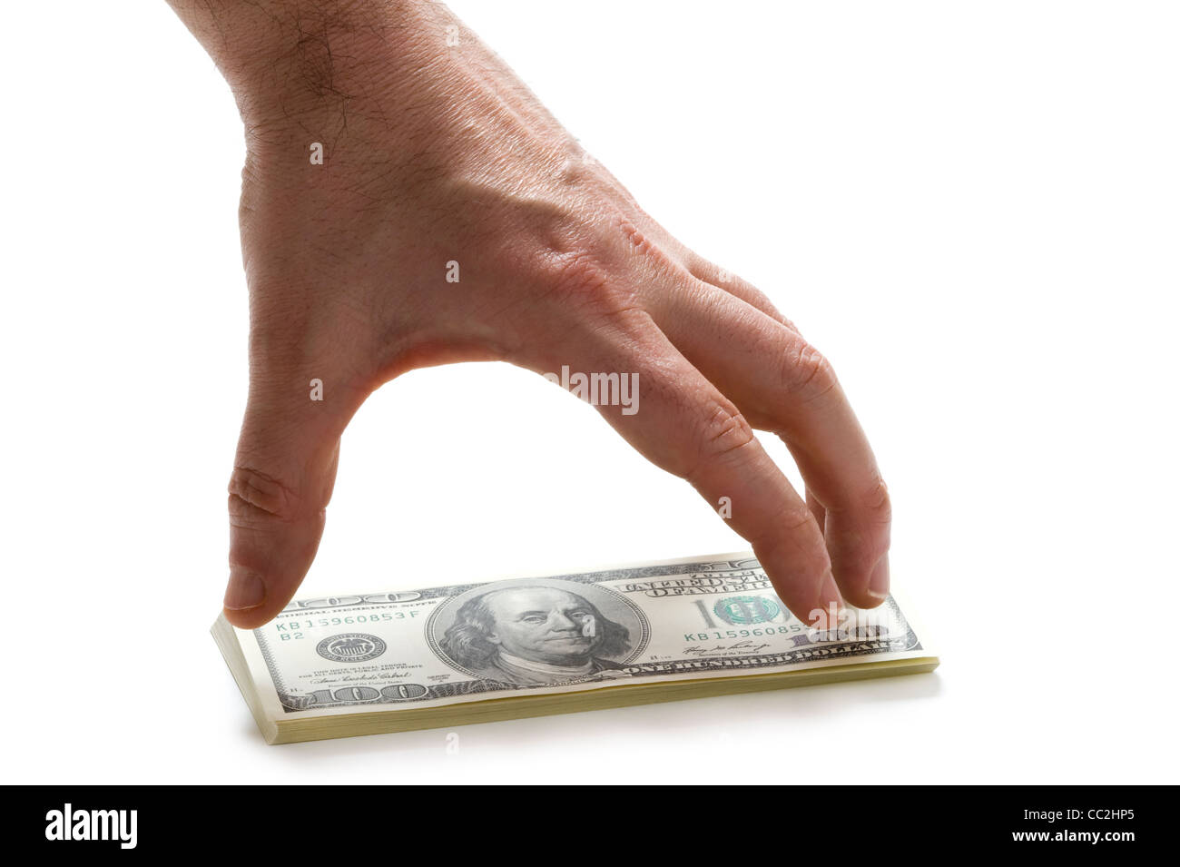 a male hand reaching for a wad of american 100 (hundred) dollar bills - Stock Image