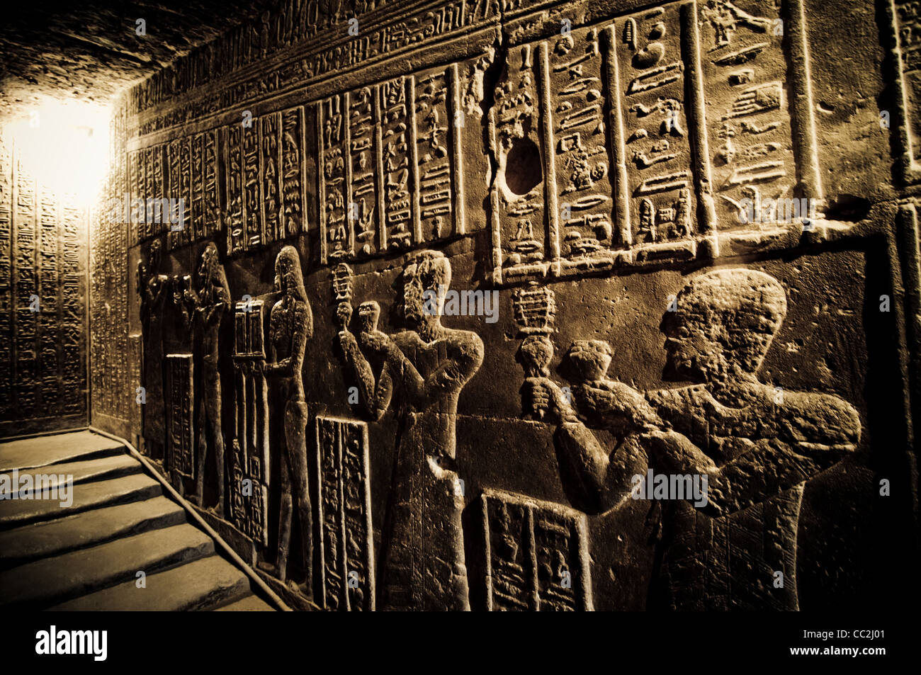 Wall reliefs of priests in the tunnels at the Temple of Dendera, Egypt, circa 200 BC - Stock Image