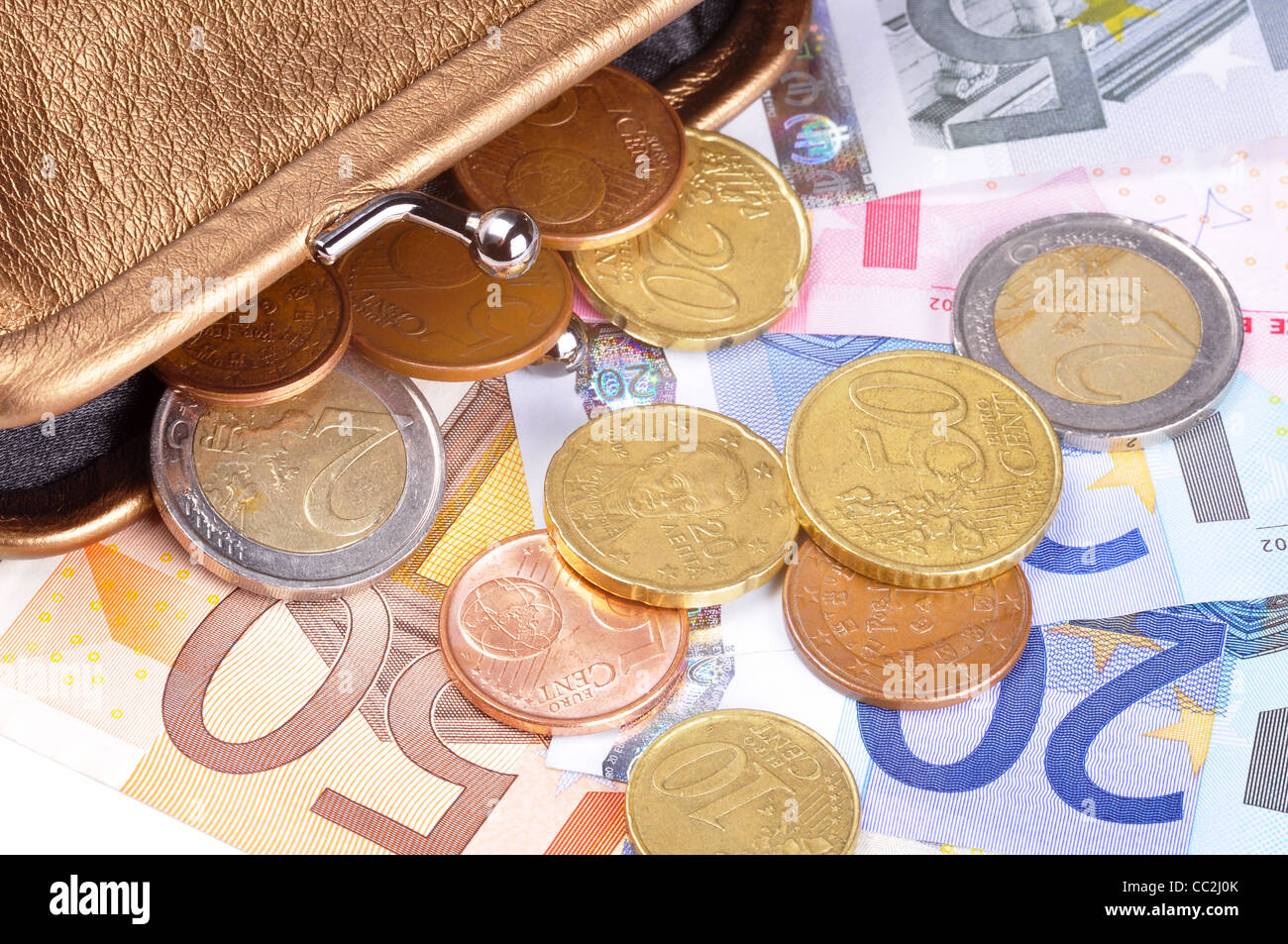 Euro bills and coins coming out of a wallet - Stock Image