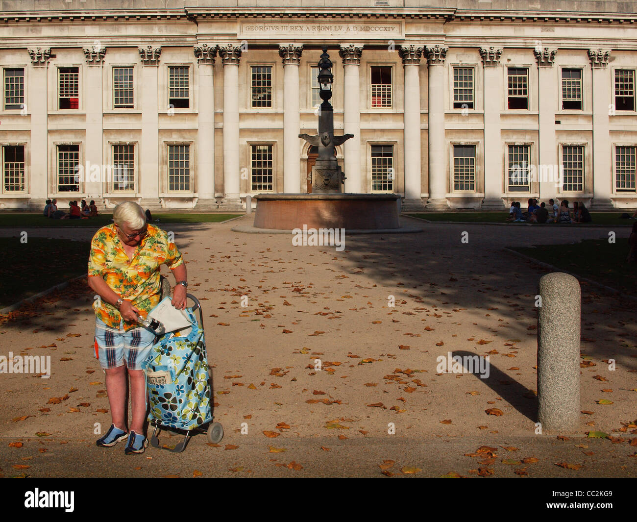 A man dressed for a hot summer's day during an unseasonal Autumnal heatwave, in Greenwich, London - Stock Image