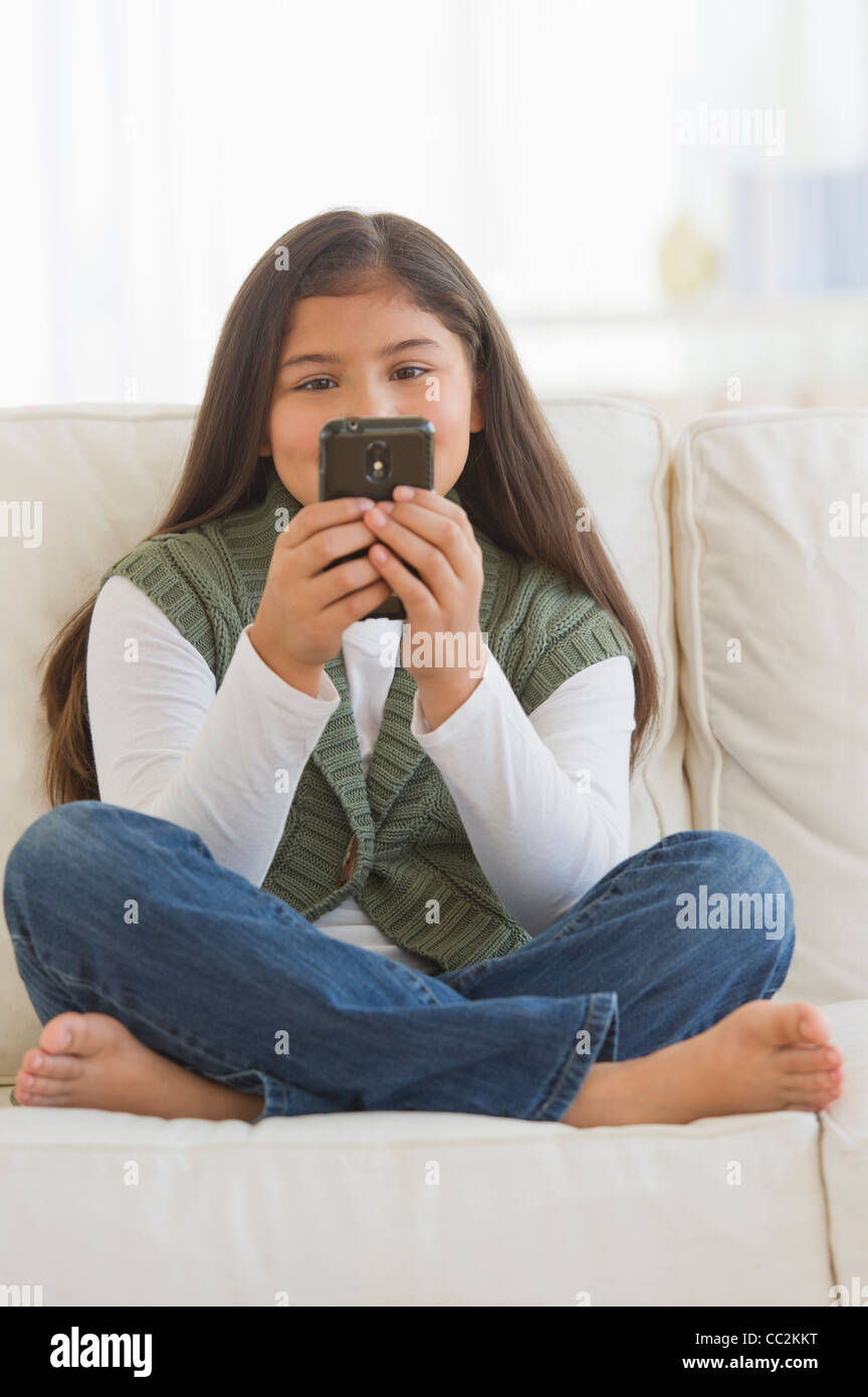 USA, New Jersey, Jersey City, Girl (10-11) using mobile phone - Stock Image