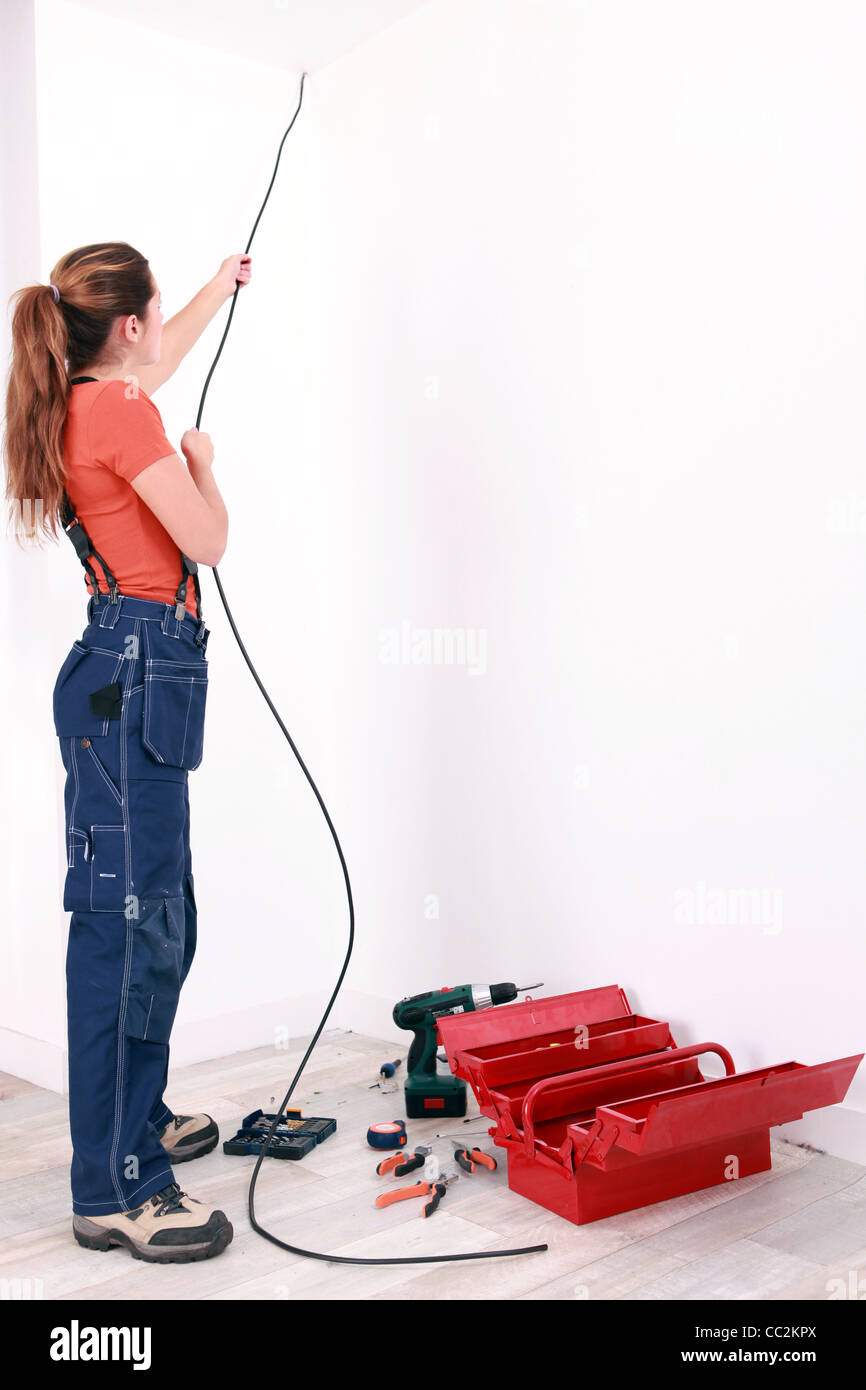 Electrician Wiring Ceiling Fan Box Stock Photos Female Pulling Cable Through Wall Image
