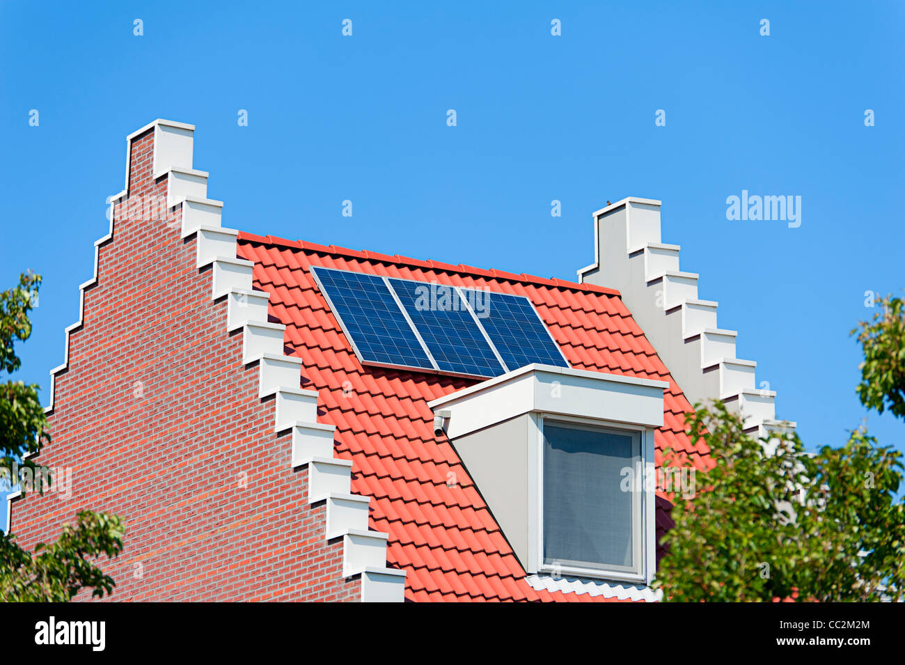Modern Dutch house with solar panels on roof - Stock Image