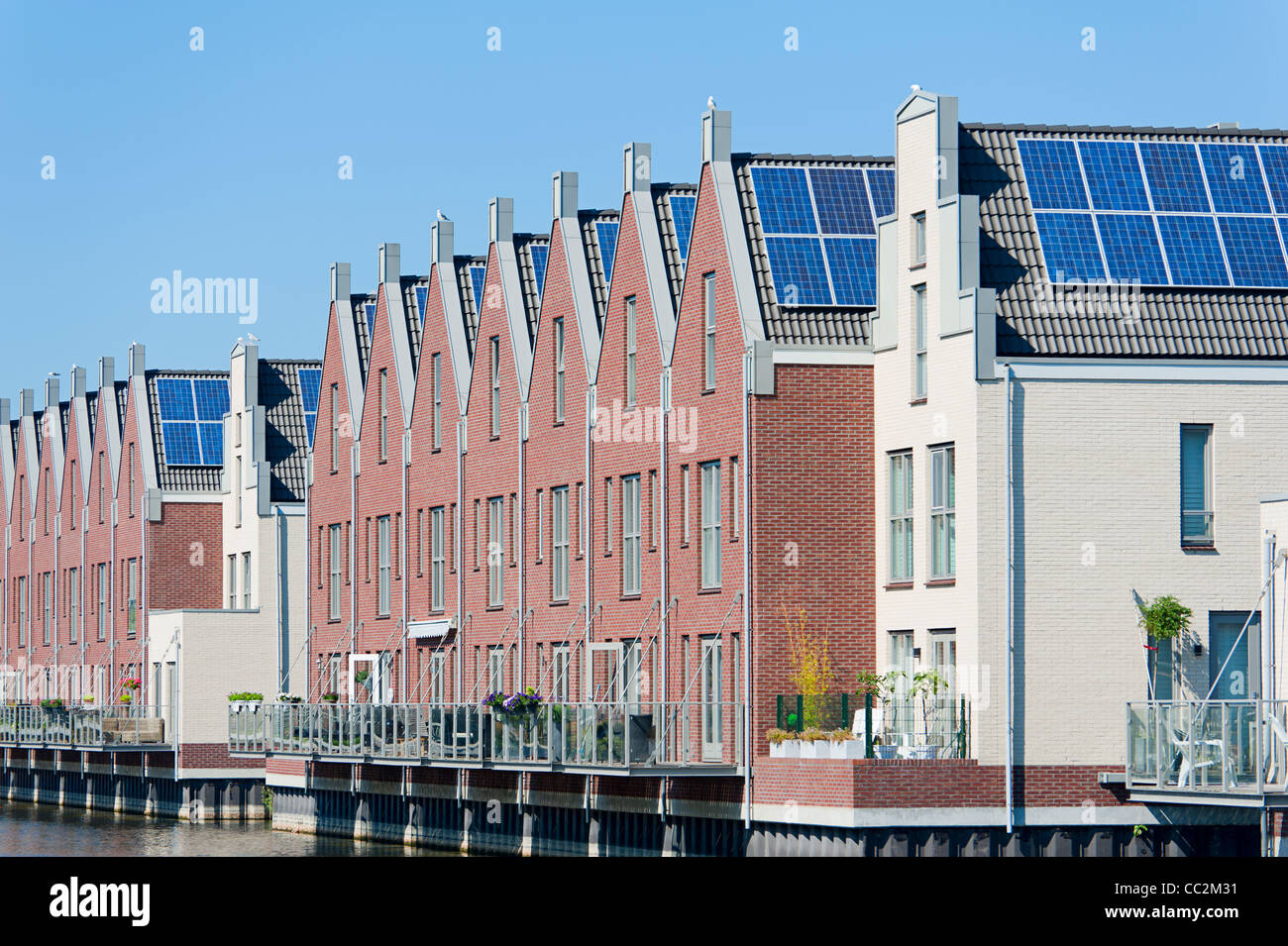 Modern Dutch houses with solar panels on roof - Stock Image