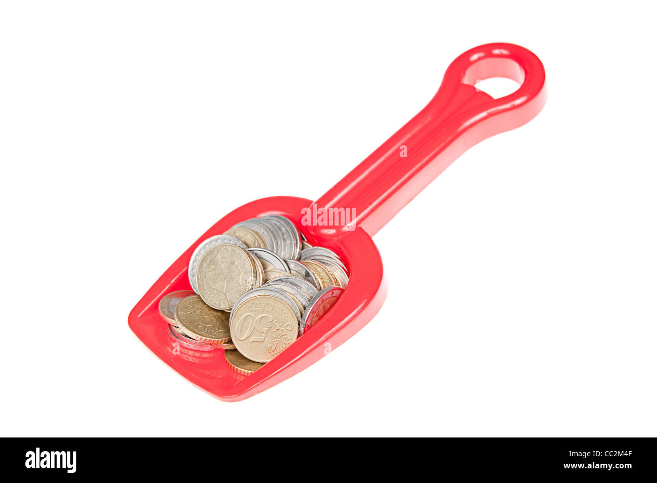 Toy shovel filled with euro coins Stock Photo