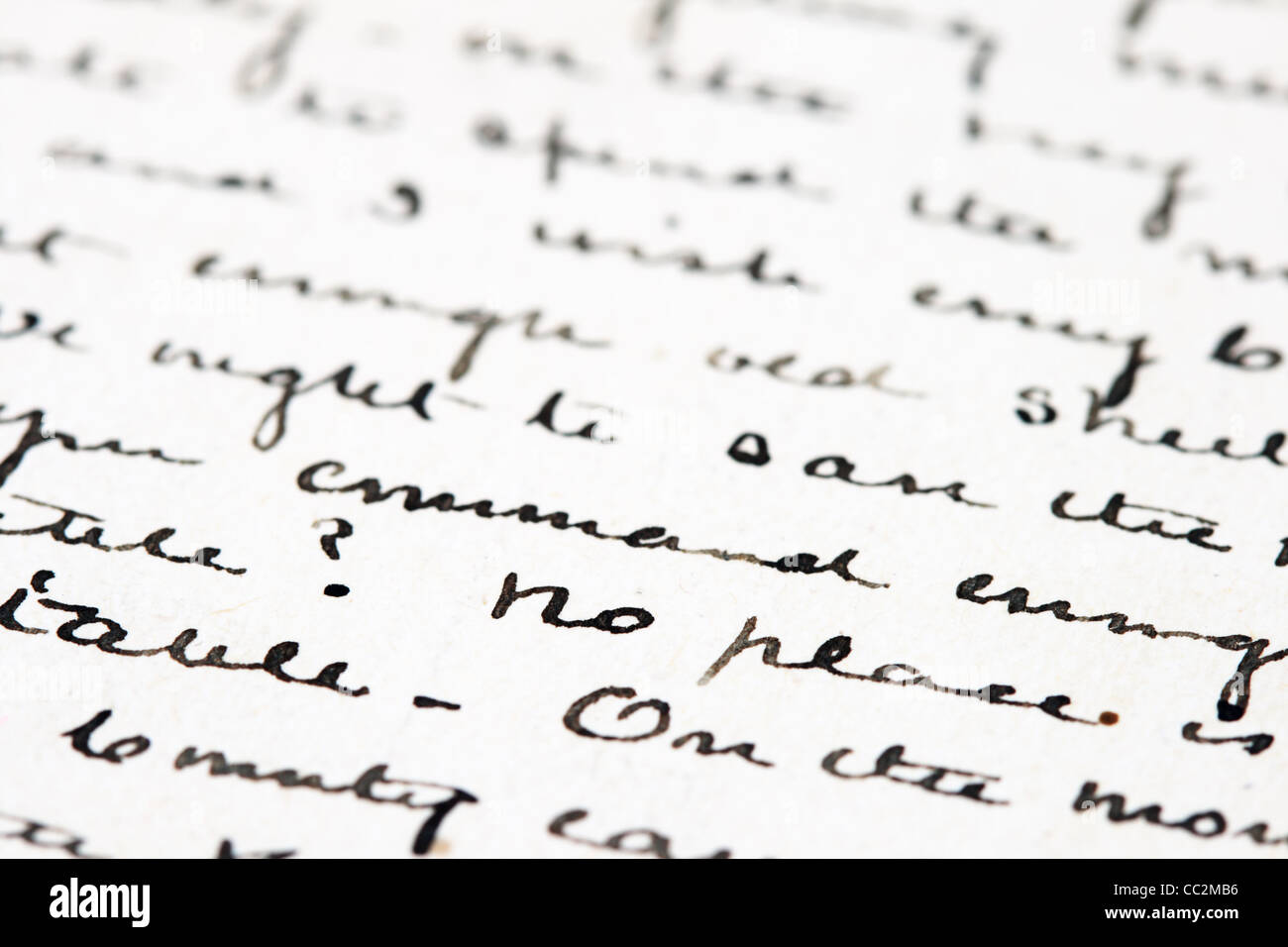 selective focus detail from an old pen and ink letter with cursive writing - Stock Image