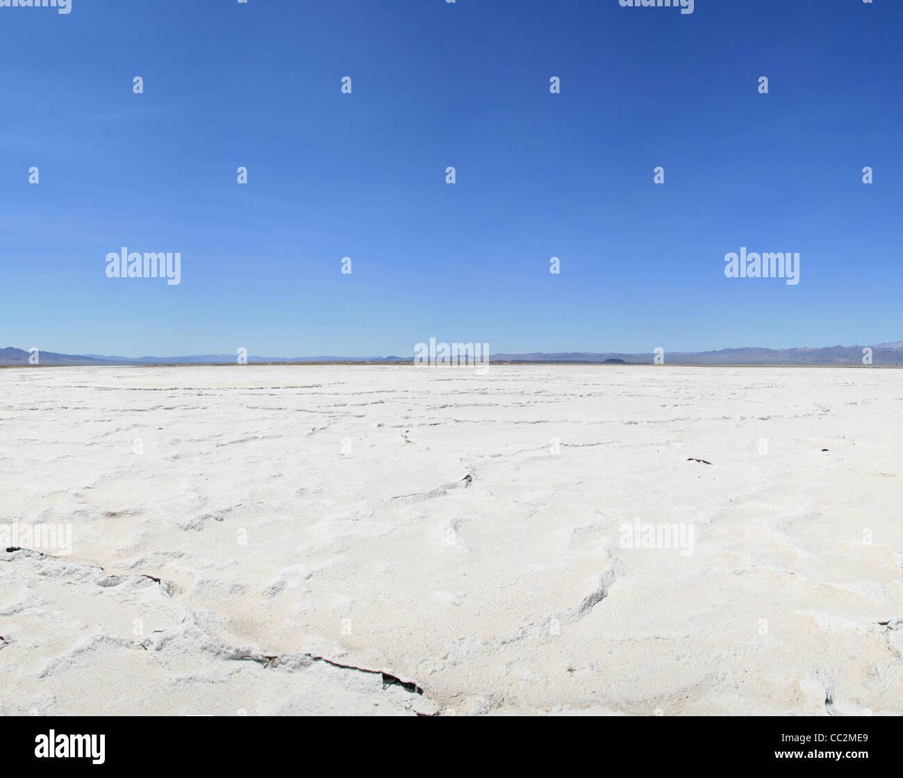 Bristol dry lake salt pan in the Mojave Desert of California with blue sky - Stock Image