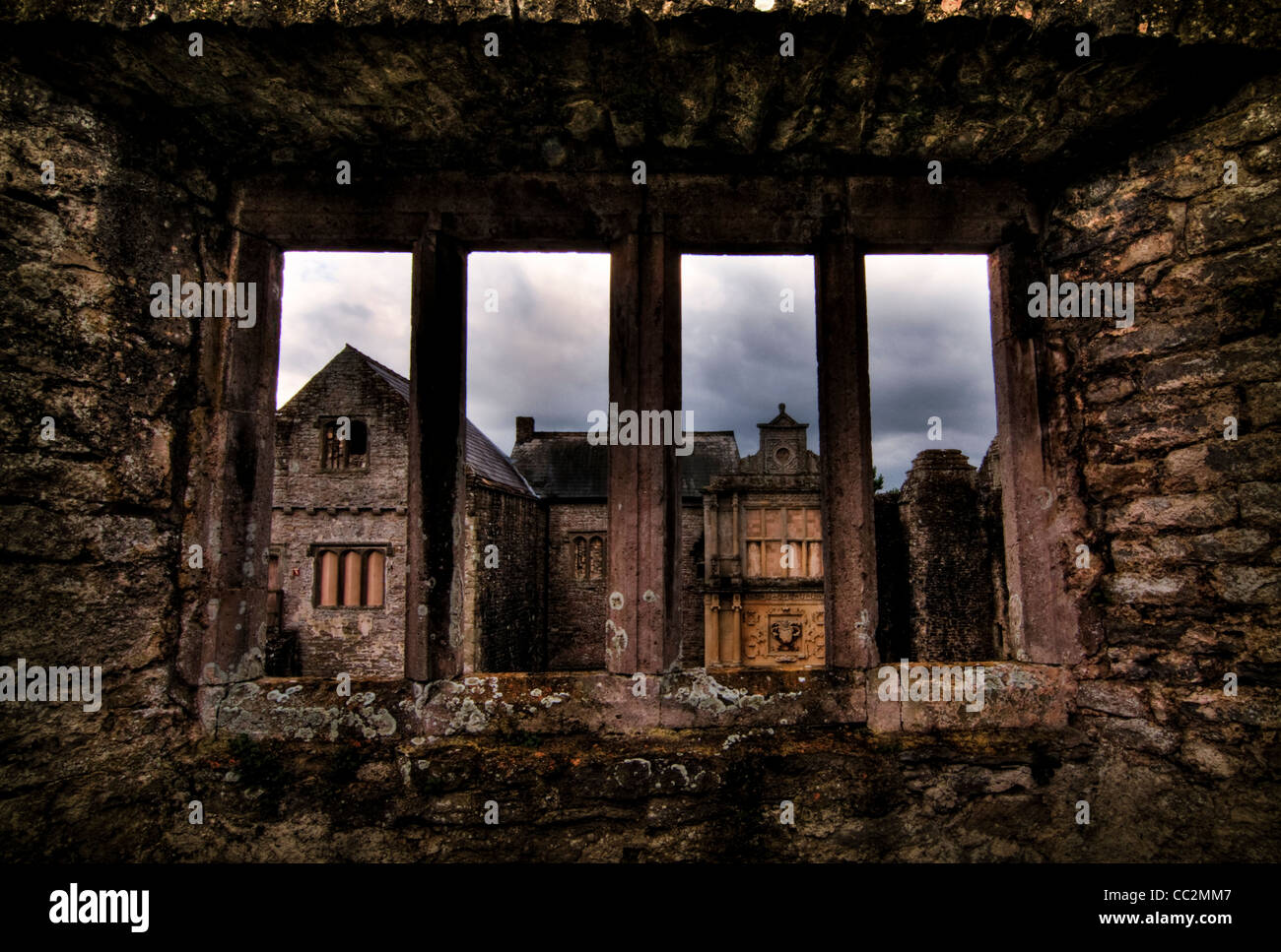 View through a stone window of ruined castle. Beaupre Castle medieval ruins in Wales. - Stock Image
