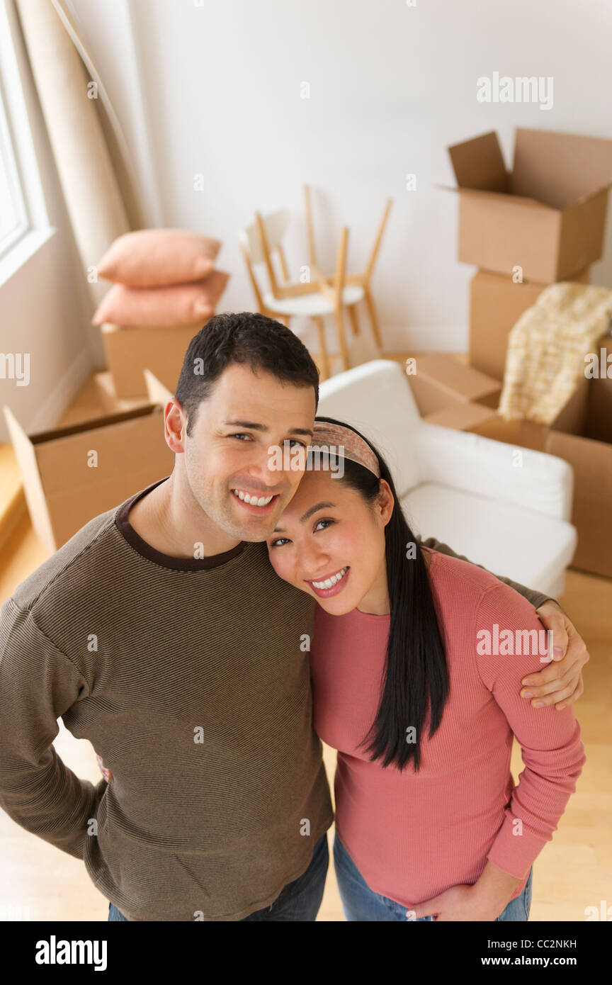USA, New Jersey, Jersey City, Portrait of couple in new house - Stock Image