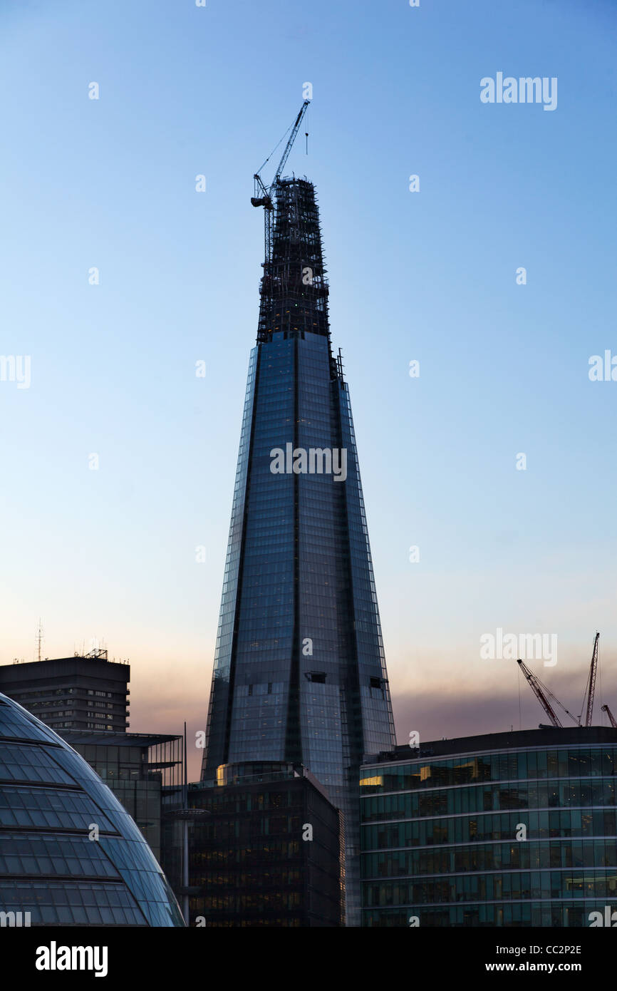 The Shard, London also known as the Shard of Glass, nearing completion as seen from Tower Bridge - Stock Image