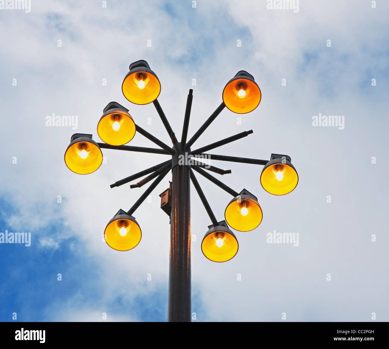 illuminating lights over sports field - Stock Image