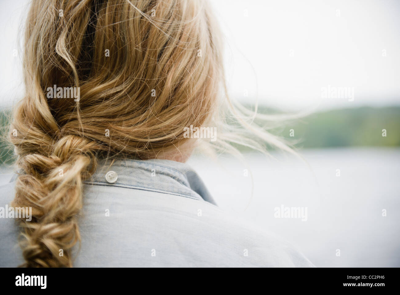 USA, New York, Putnam Valley, Roaring Brook Lake, Close up of woman's blond and braided hair - Stock Image