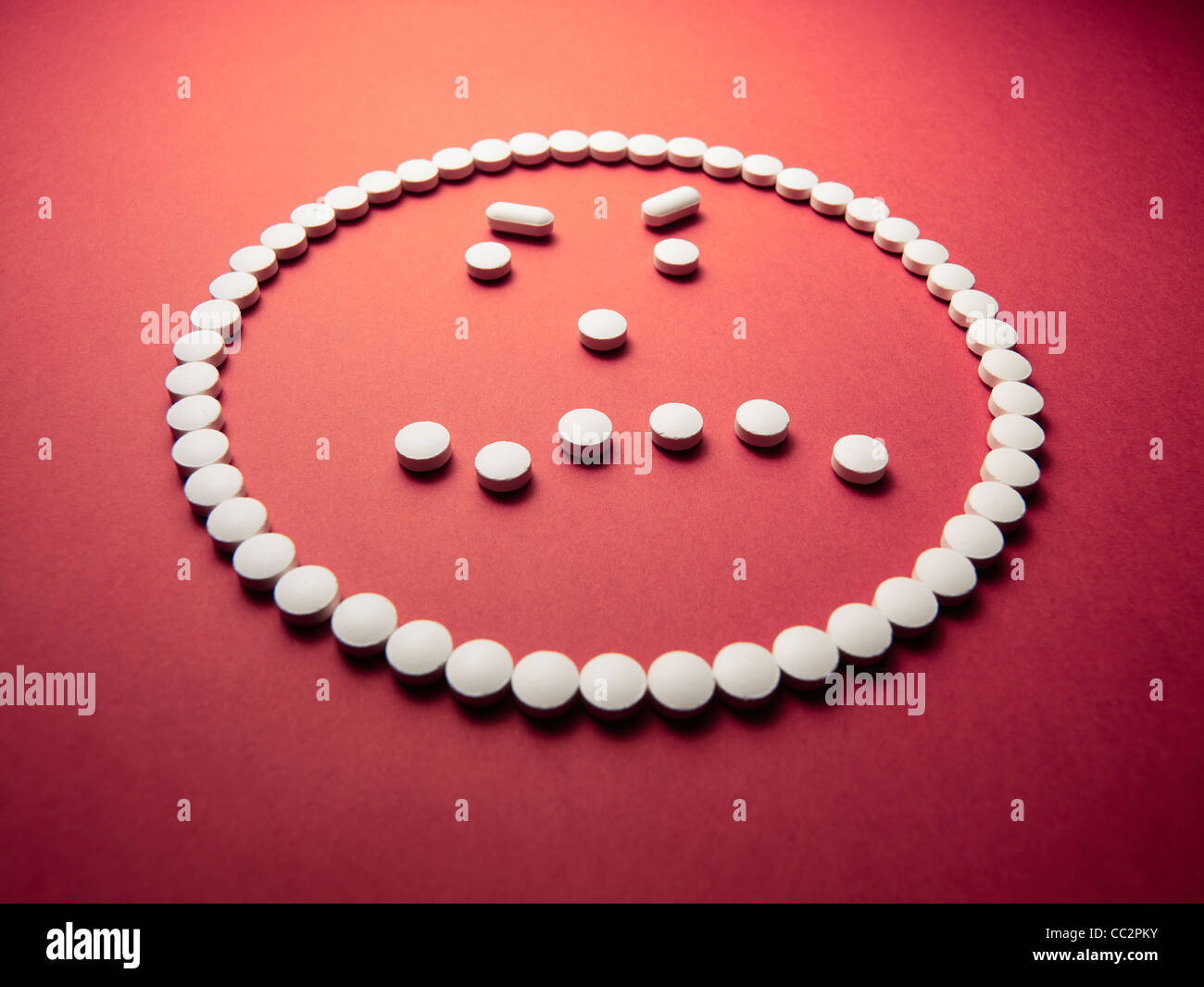 sad face made out of pills and drugs - Stock Image