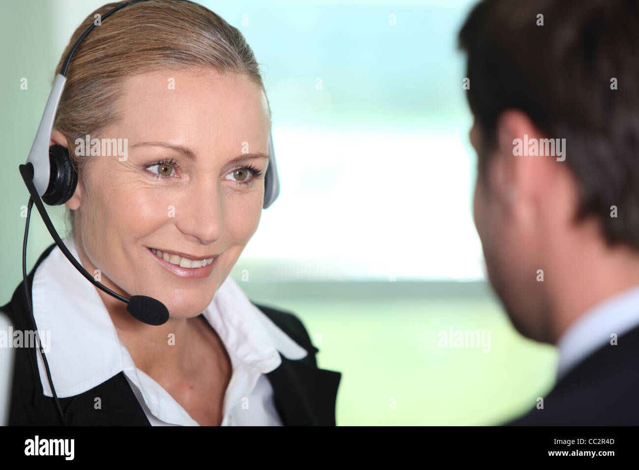 Interpreter with client - Stock Image