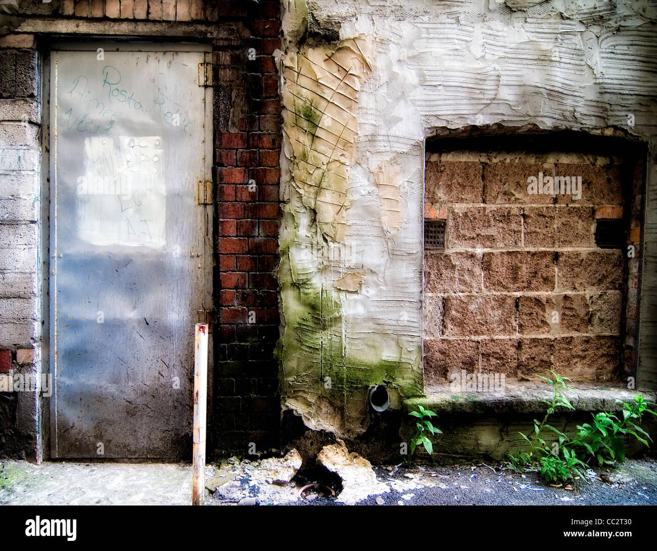 Filled in derelict doorway and window - Stock Image