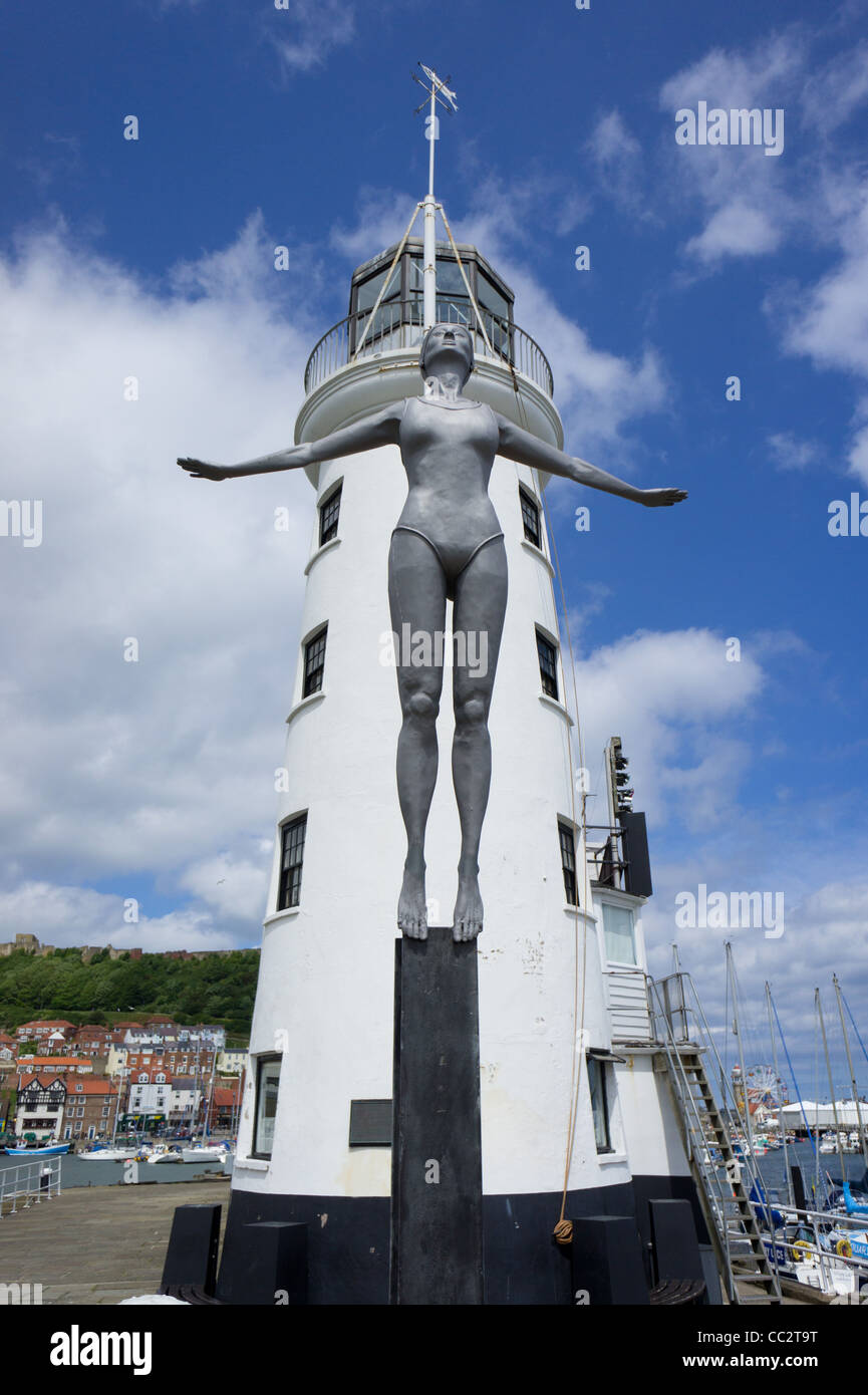 'Belle' sculpture and Scarborough Lighthouse North Yorkshire England - Stock Image