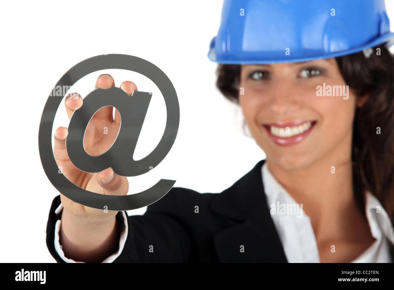 Female architect holding at symbol - Stock Image