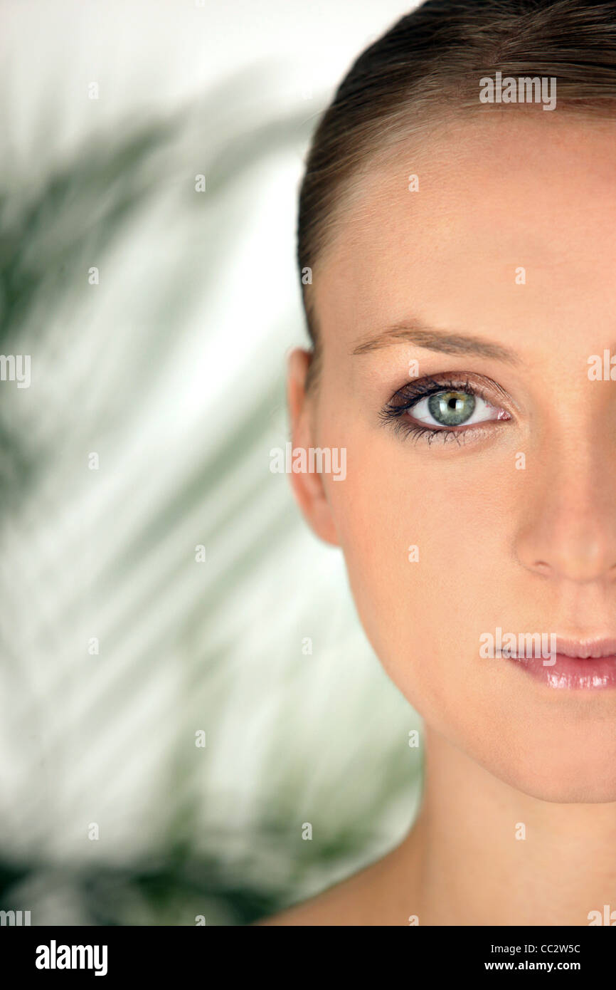half face of blonde with plastered hair - Stock Image