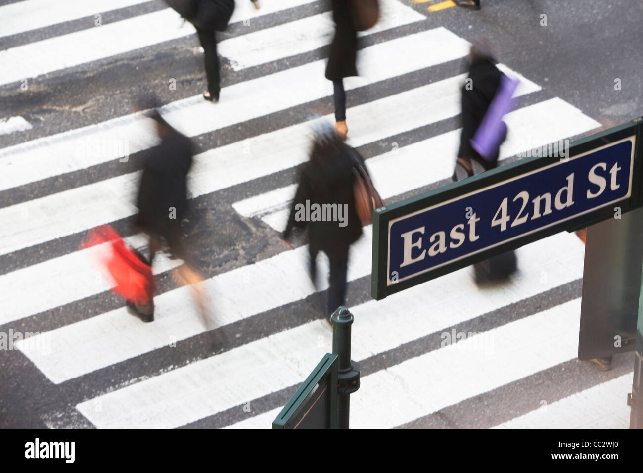 USA, New York City, Manhattan, 42nd street, Pedestrians on zebra crossing - Stock Image
