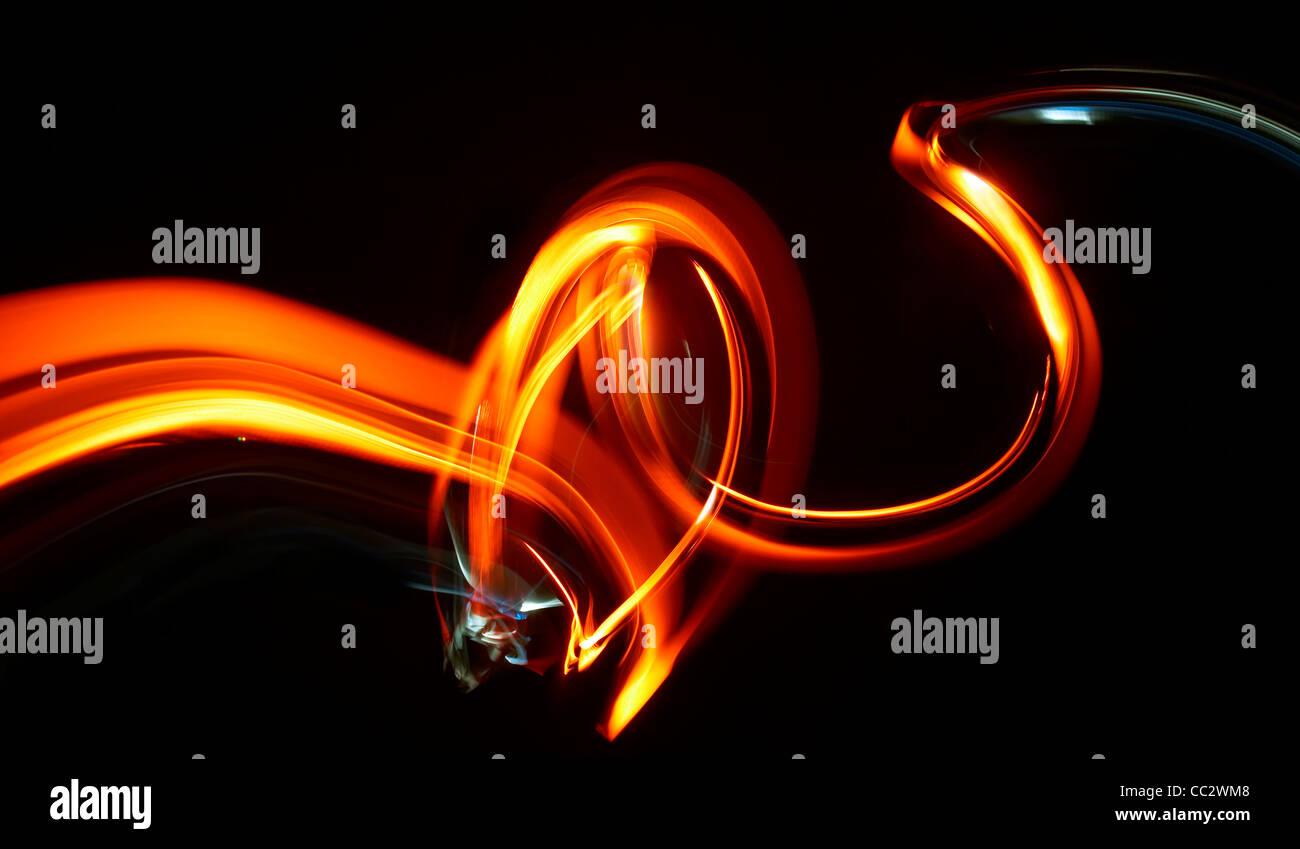 Abstract Orange Red Yellow Neon Light Swirls - Stock Image
