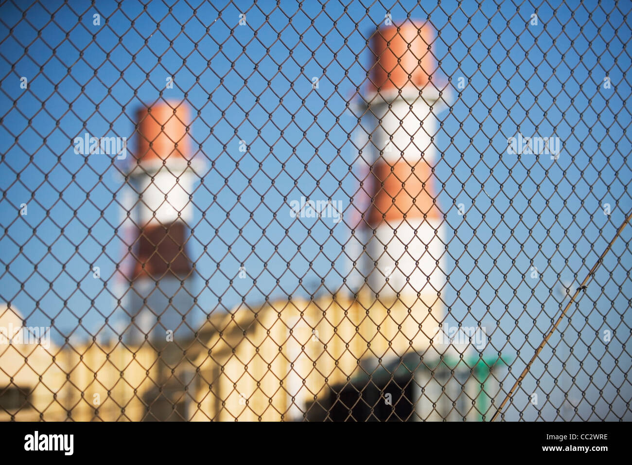 USA, New York City, Industrial plant behind wire mesh fence Stock Photo
