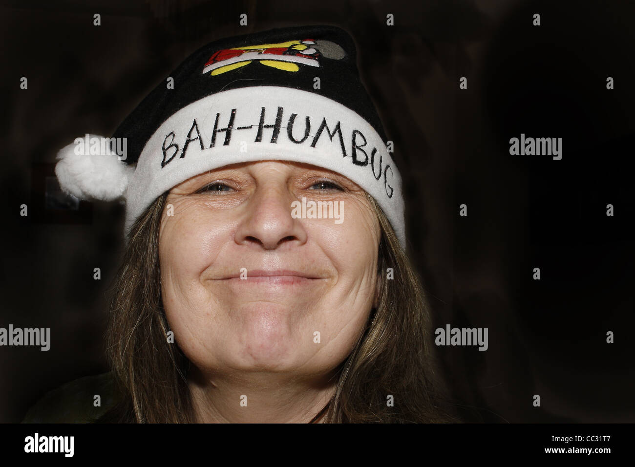 middle-aged woman wearing bah humbug hat Stock Photo