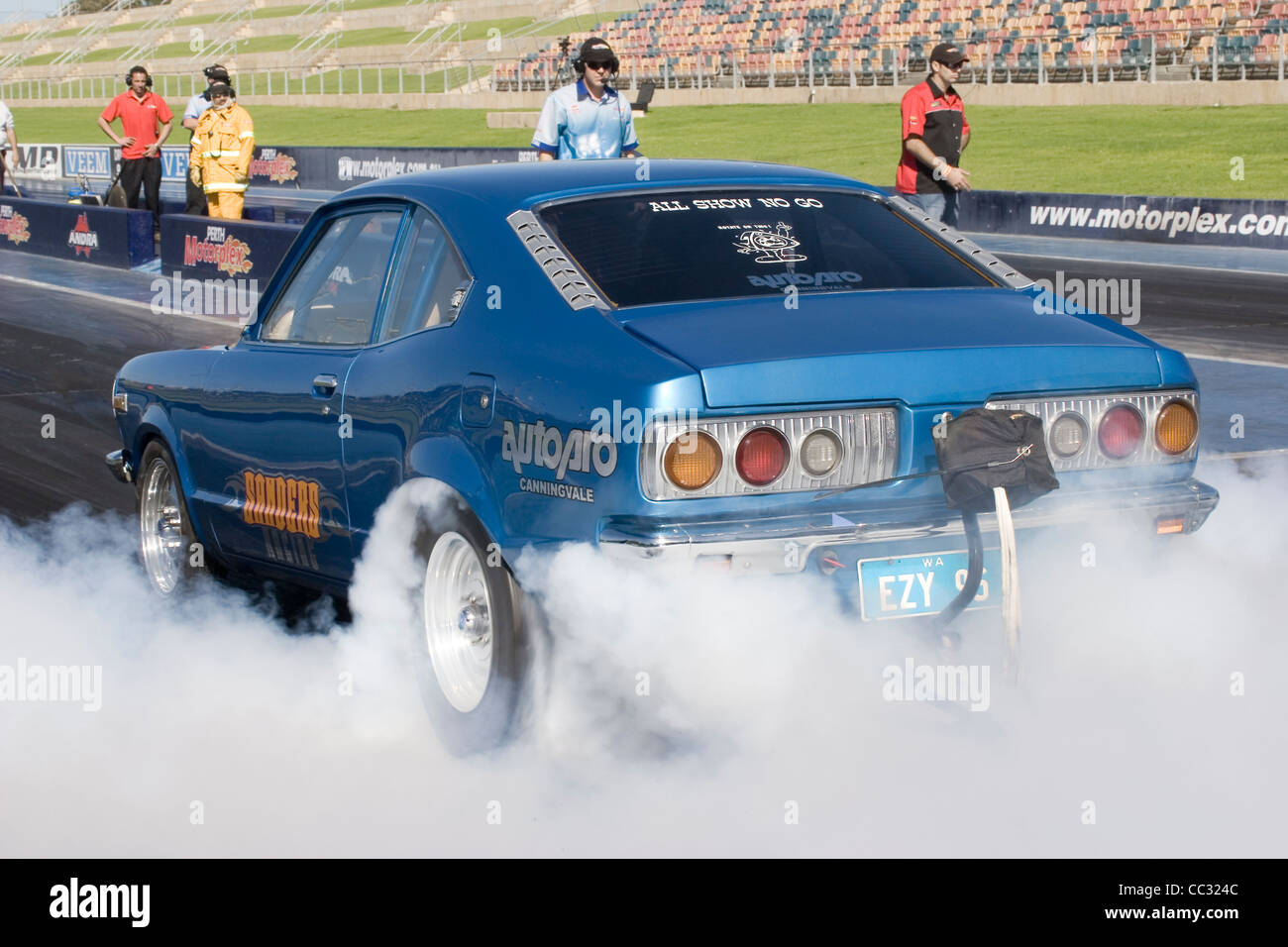 Australian Lee Sanders performs a tire smoking burning rubber burnout in his Mazda RX3 rotary engined drag racing Stock Photo