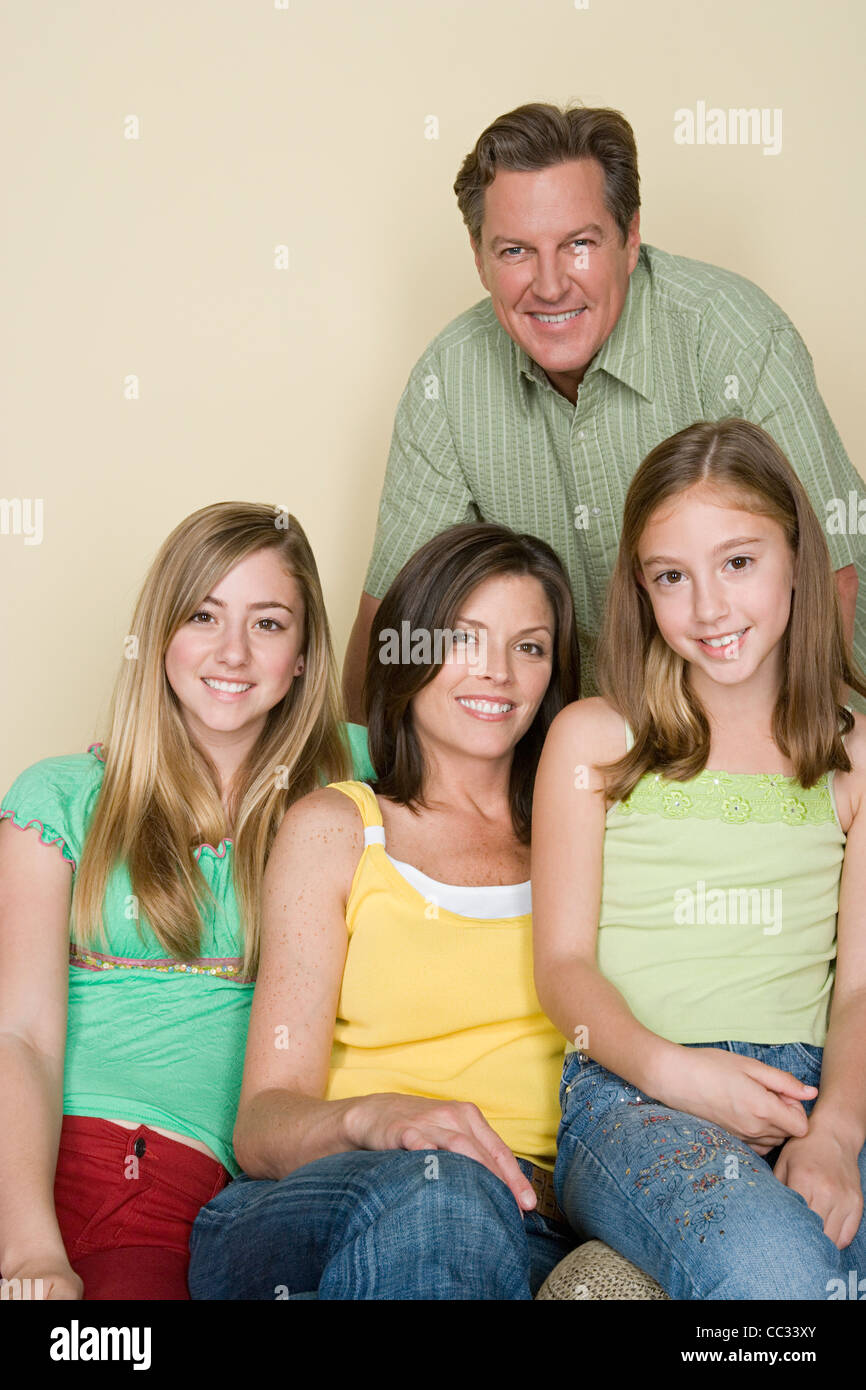 Portrait of happy three-generation family with two girls (8-9, 14-15) - Stock Image