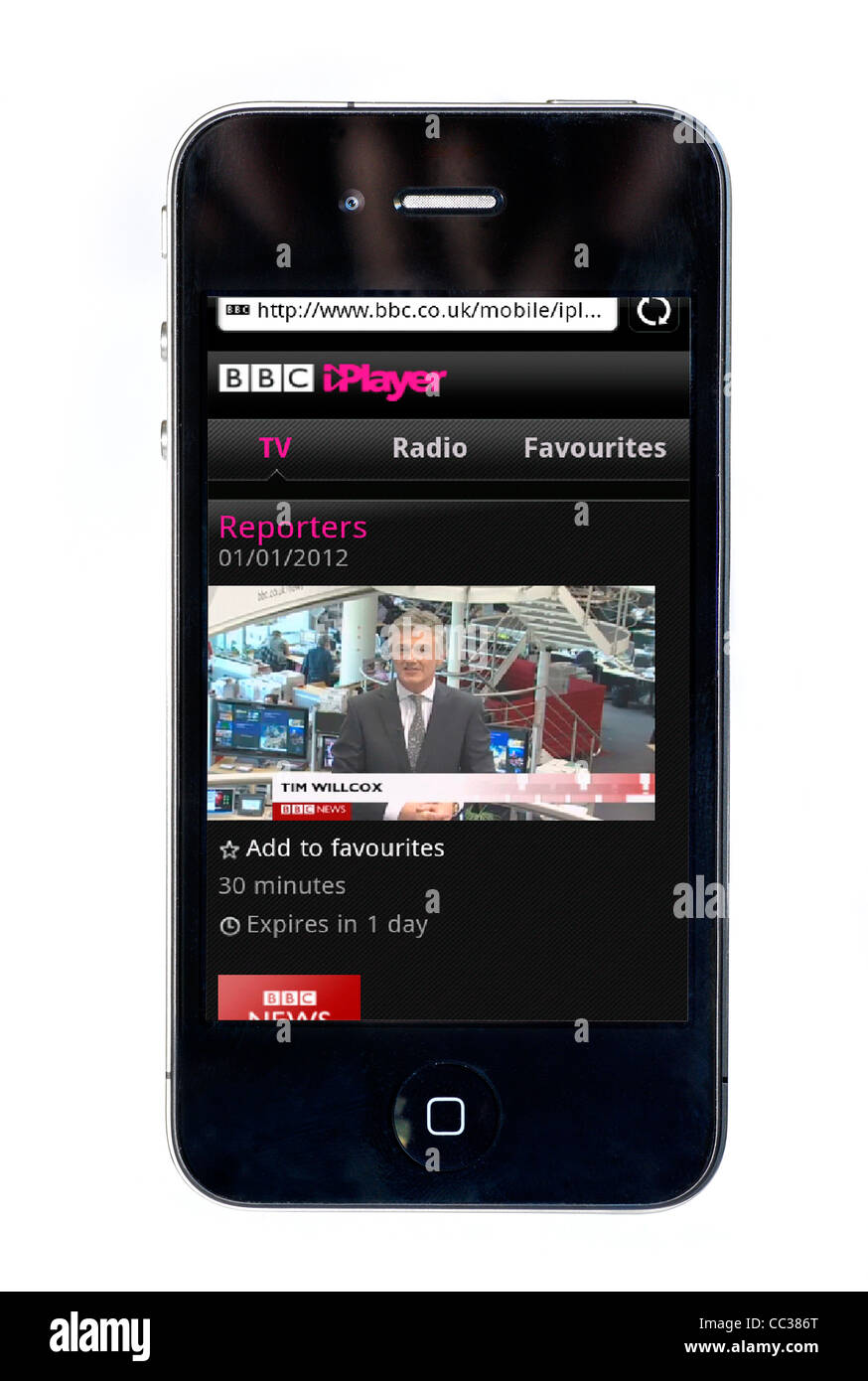 Watching the BBC News Channel on the BBC iPlayer on an Apple iPhone 4 smartphone - Stock Image