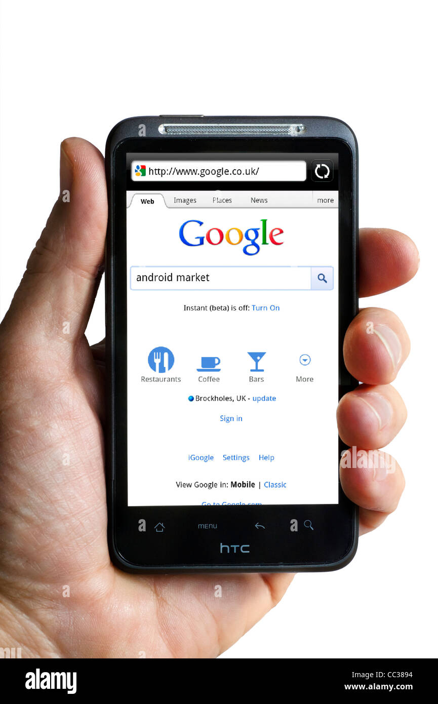 Performing a Google search on an HTC smartphone - Stock Image