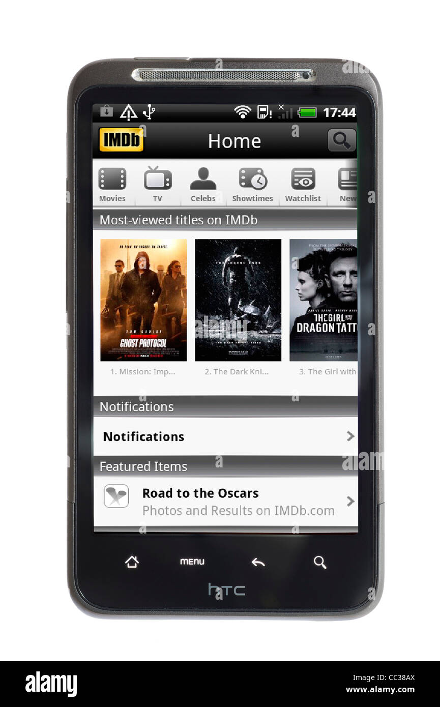 The film and tv site, IMDb, on an HTC smartphone - Stock Image