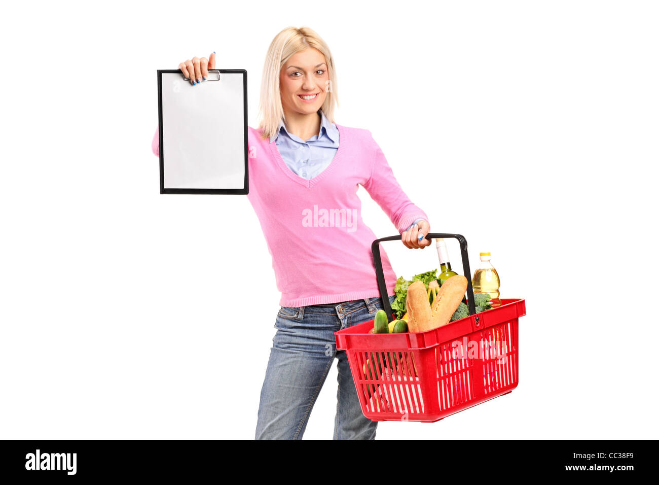 A female holding a shopping basket and showing a clipboard Stock Photo