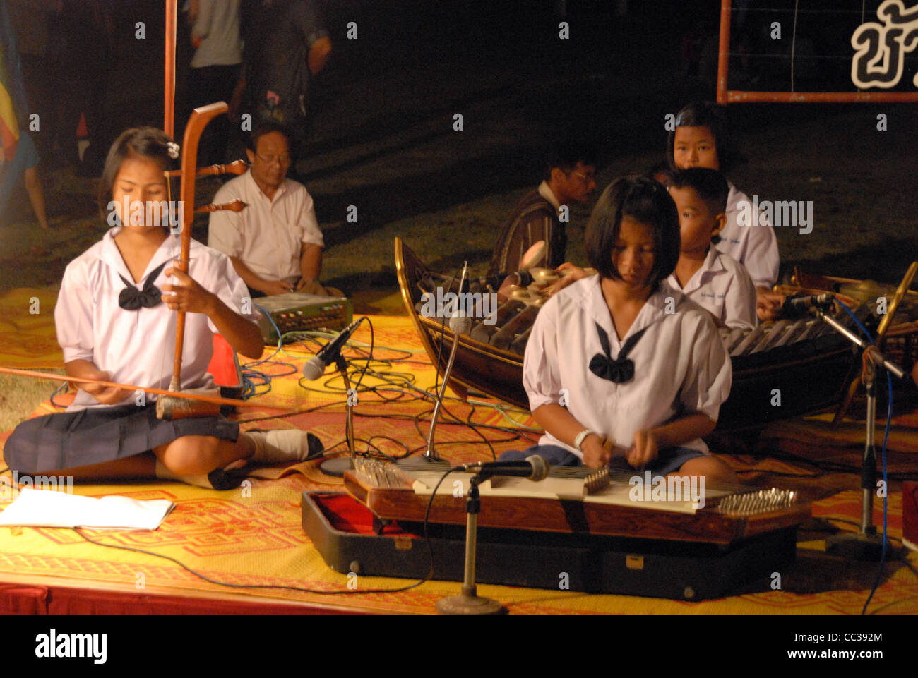 School children playing Thai classical instruments in Sukhothai, northern Thailand - Stock Image