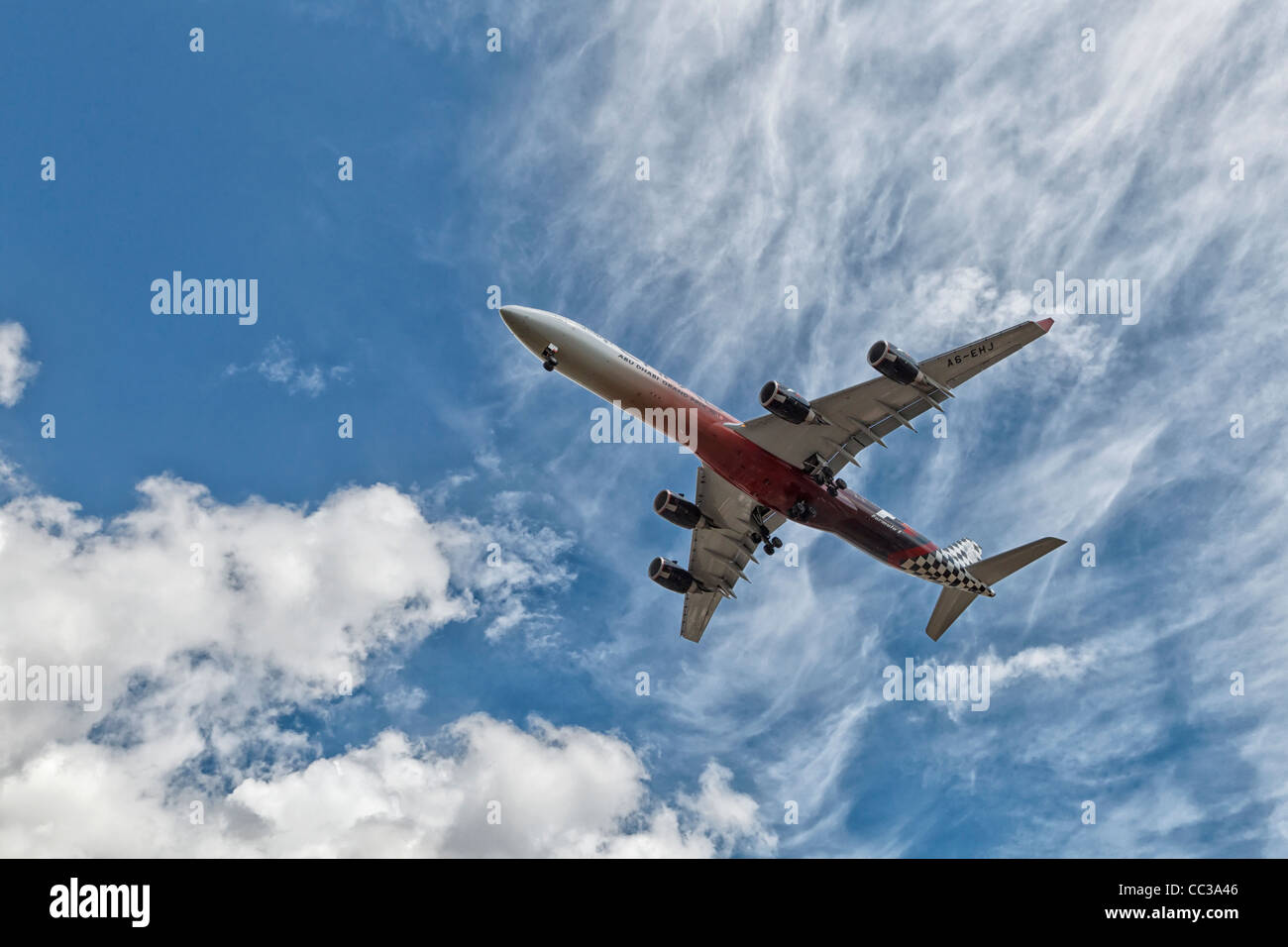 An Airbus A340 of Etihad Airways on final approach - Stock Image