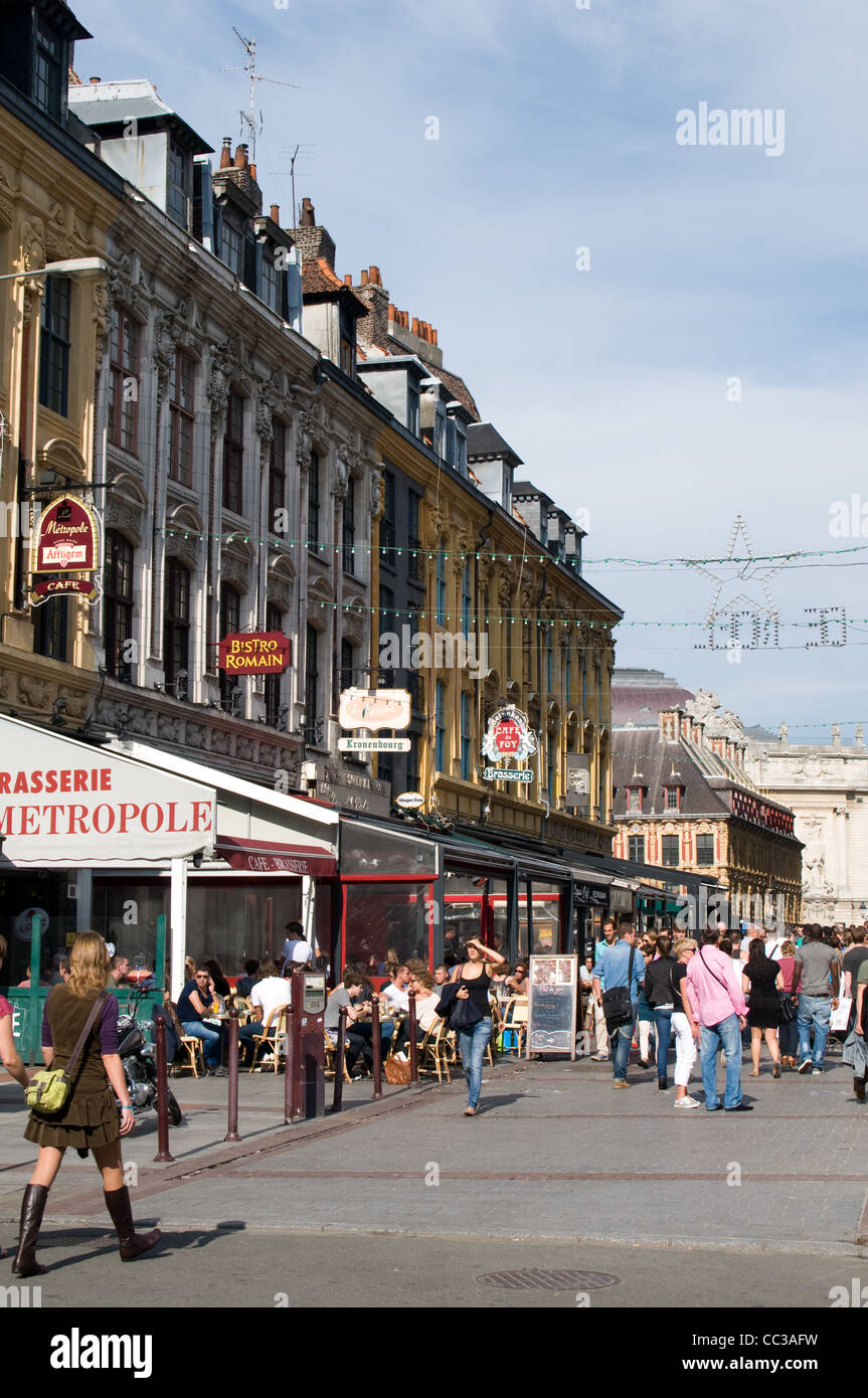 Visitors and locals enjoy the cafés and restaurants in Pl. Rihour, Lille, France on a sunny day - Stock Image