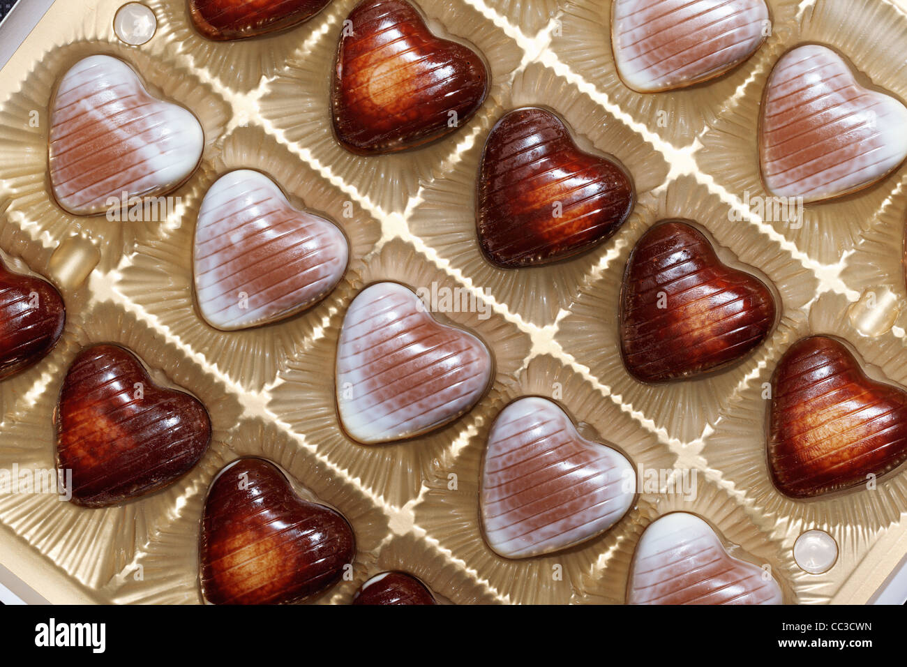 Heart shape chocolate in box close-up - Stock Image