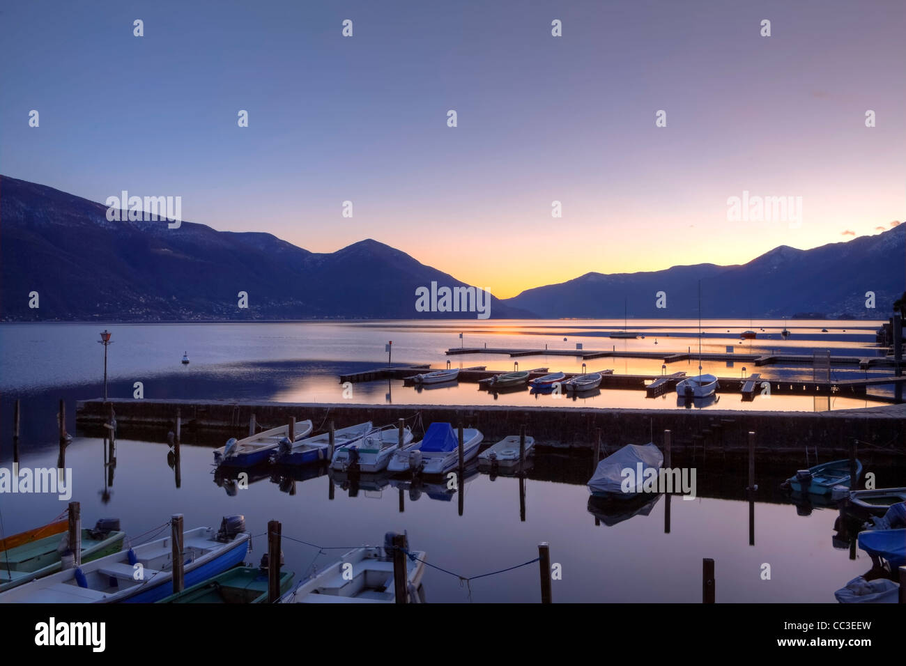 Bootsstege in Ascona, Ticino, Switzerland at sunset during the blue hour. - Stock Image