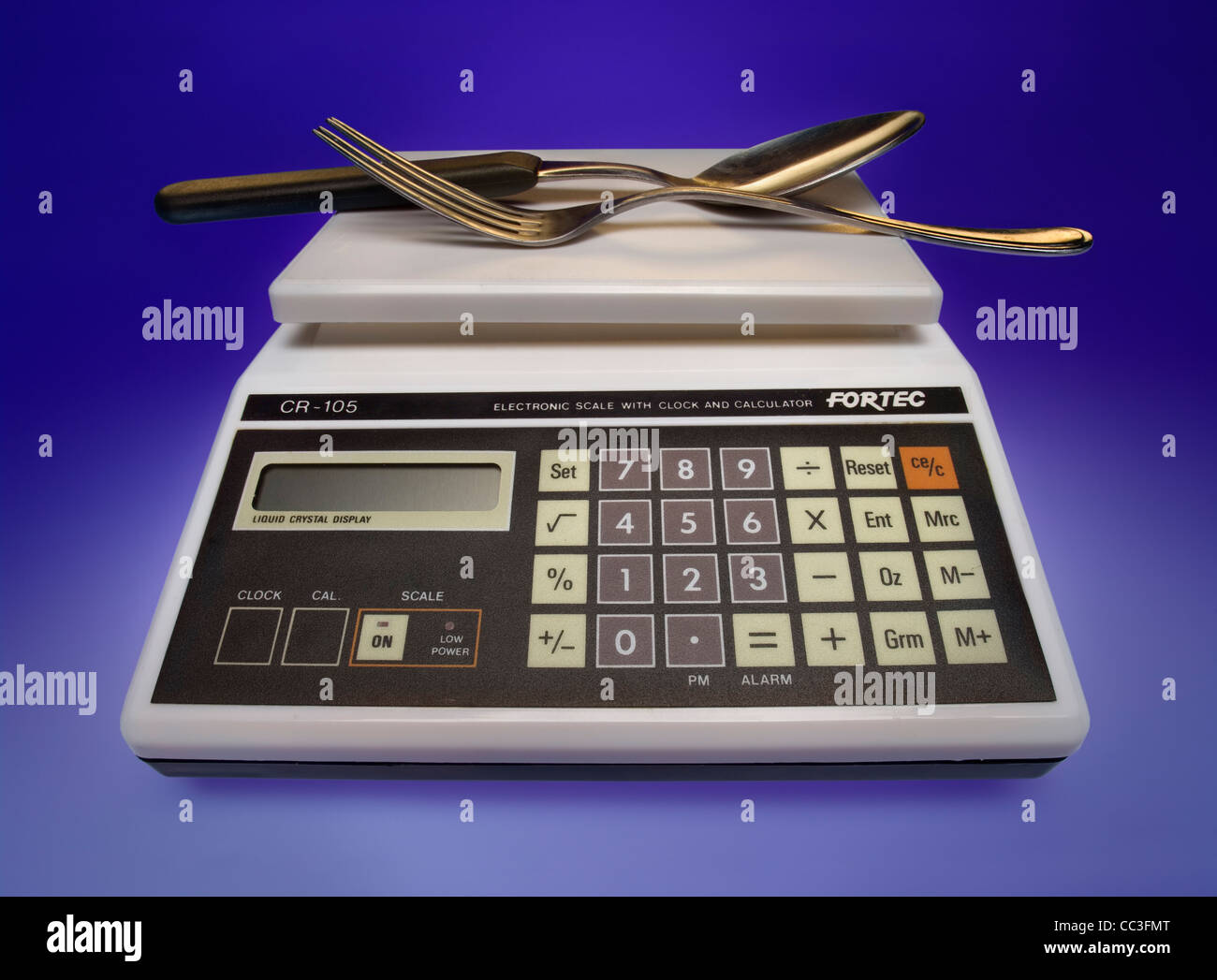 Retro electronic scale with clock and calculator - Stock Image