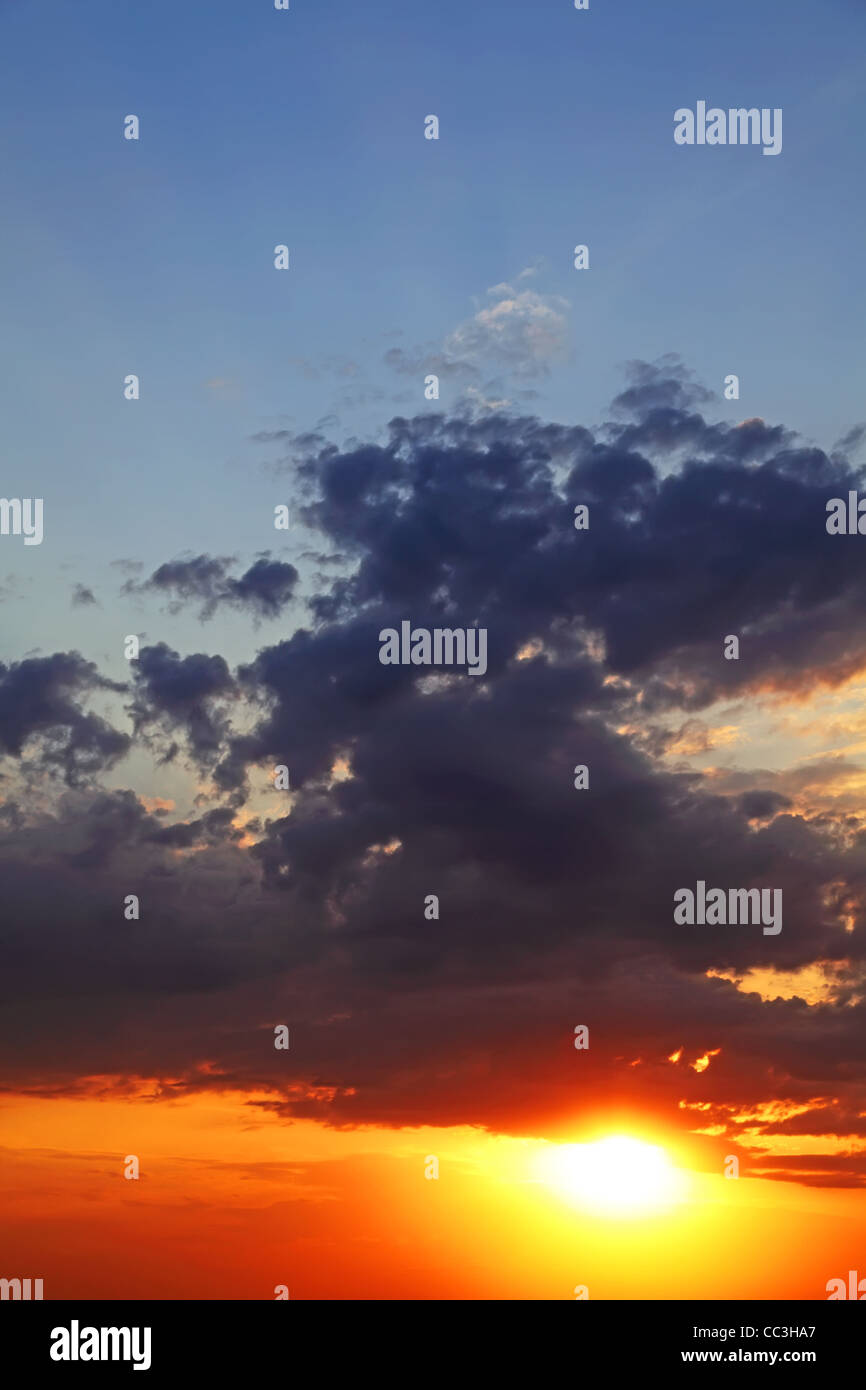 Sky with clouds at sunset. Vertical composition. - Stock Image