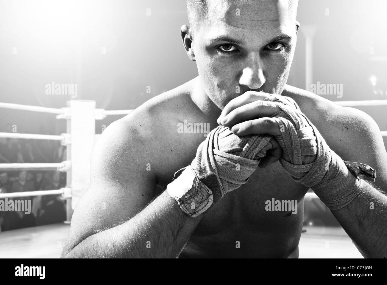 Kickboxer sitting  on the fighting ring - Stock Image