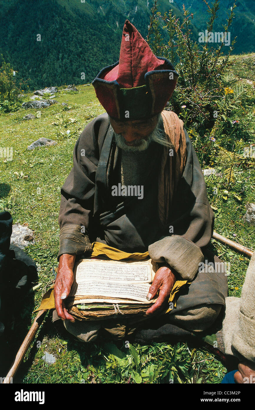 High Angle View Of A Lama Reading A Scripture, Bhutan - Stock Image