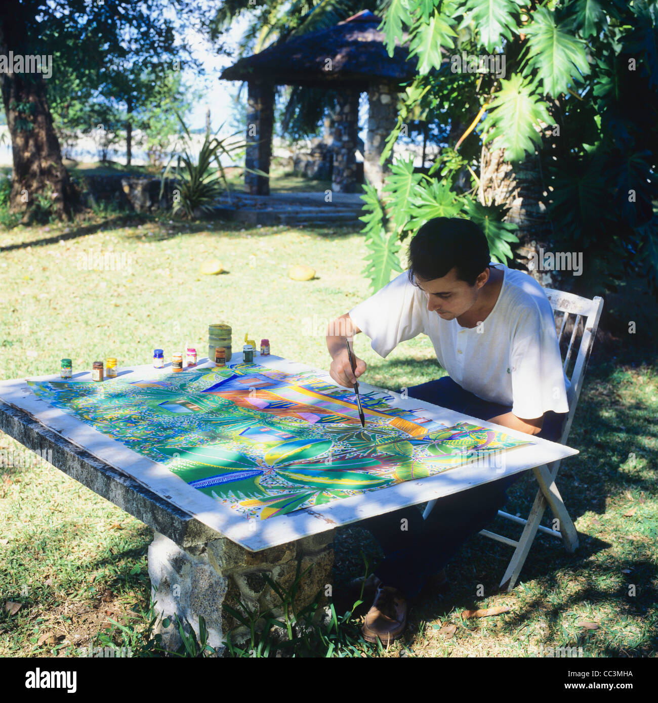 Local artist, naive painter at work, Seychelles - Stock Image