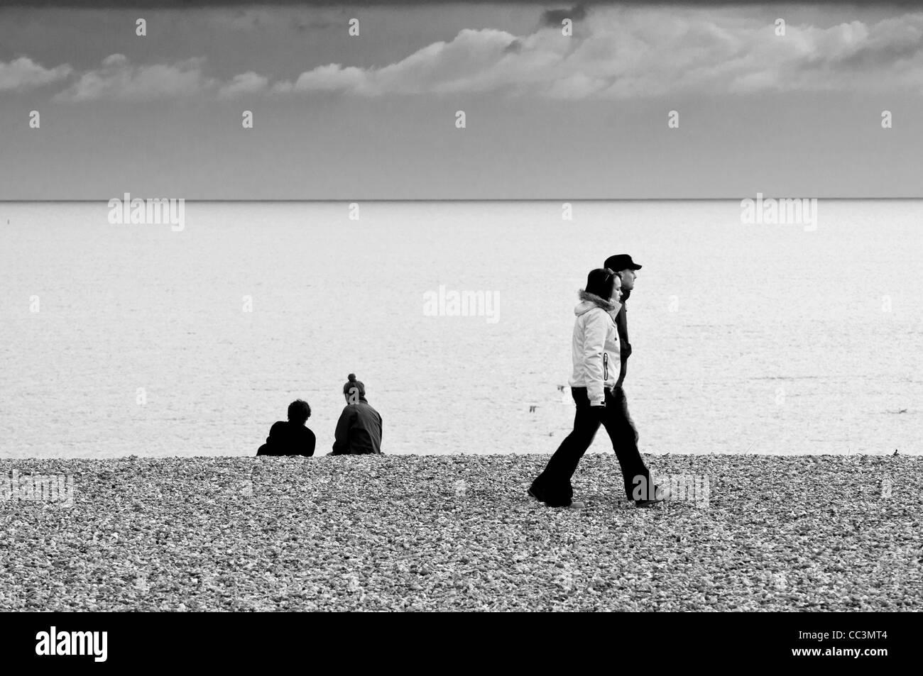 people walking on pebble beach,brighton,sussex,england,uk,europe Stock Photo