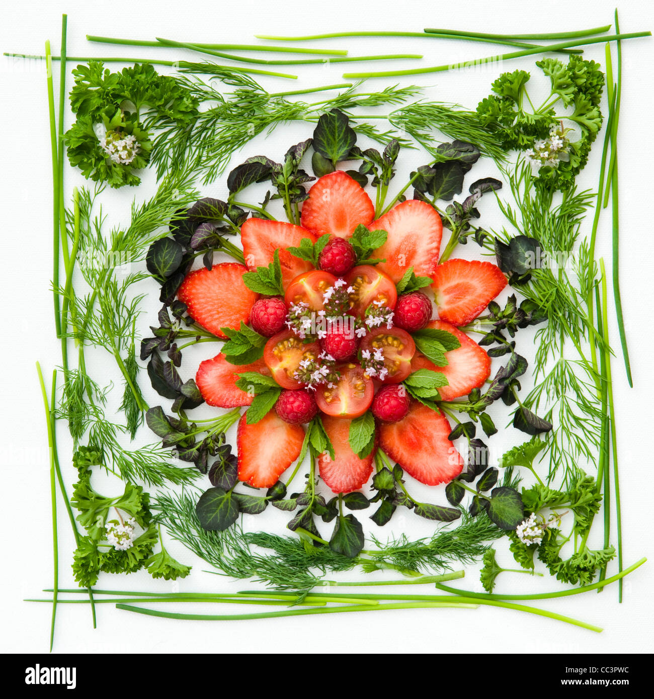 English fruit, herbs and red watercress combined to make a floral platter - Stock Image