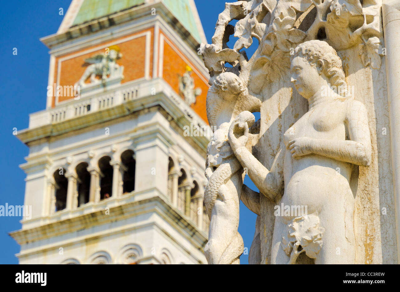 Italy, Veneto, Venice, The Campanile (Bell Tower) and carving on corner of Doges' Palace - Stock Image