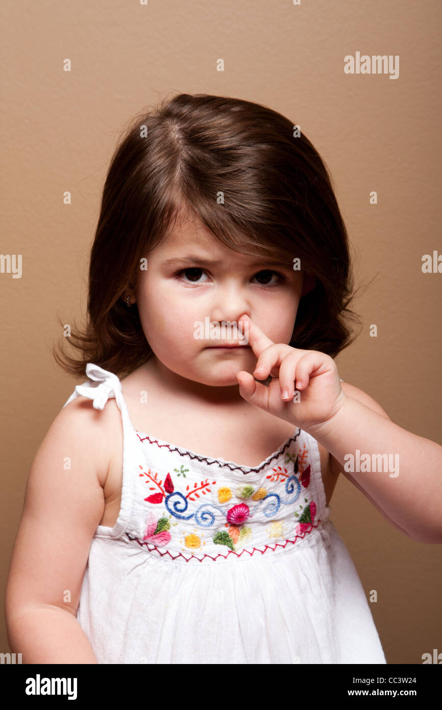 girl picking her nose stock photos girl picking her nose stock