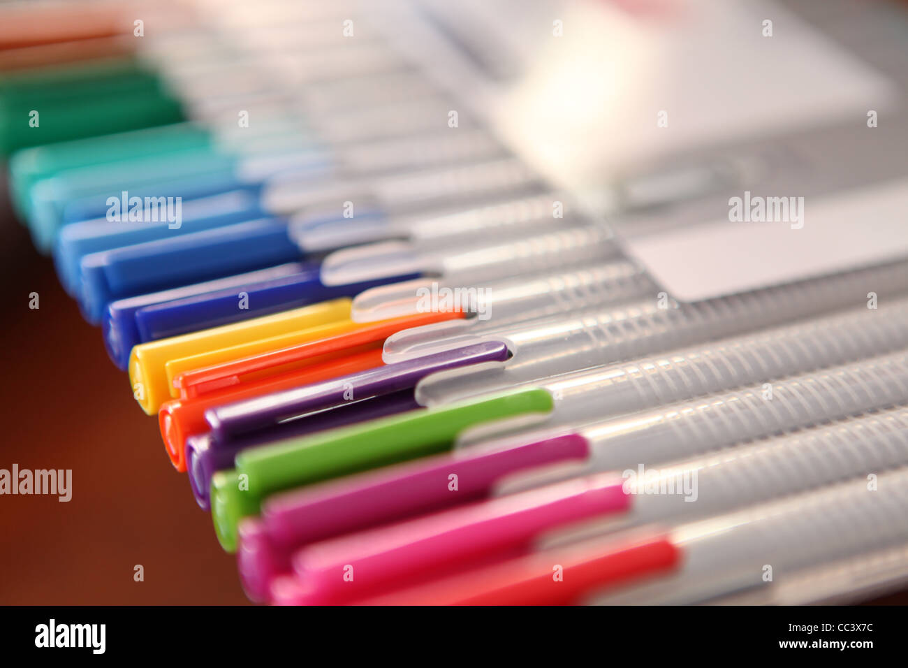 ROW OF COLOURED ARCHITECTS PENS - Stock Image
