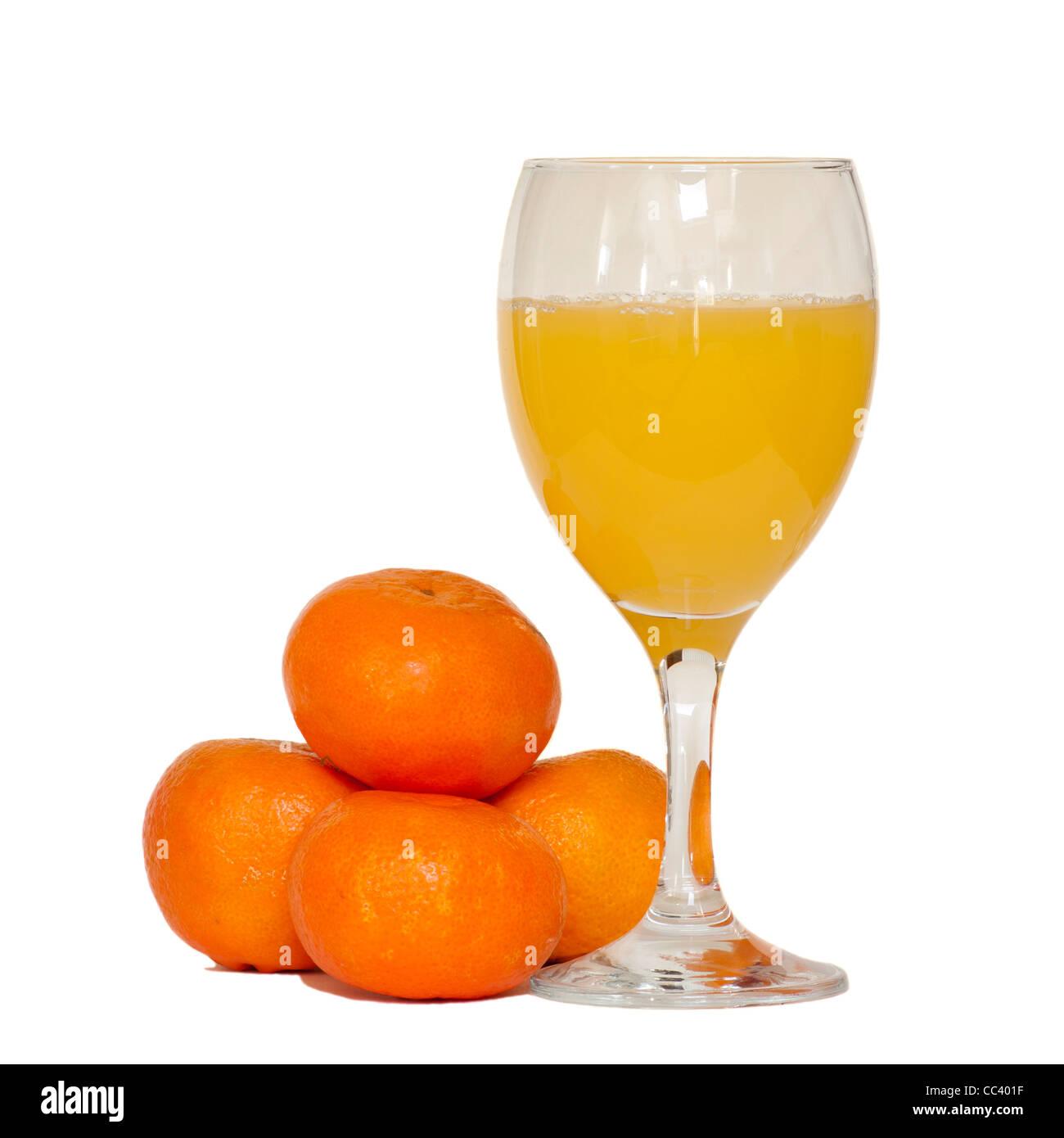 Glass Of Fresh Orange Juice Satsumas Oranges - Stock Image