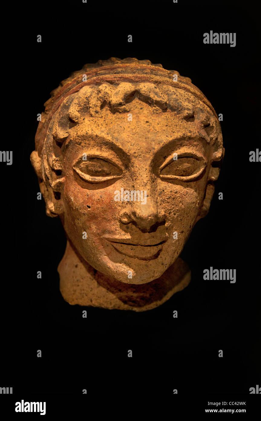 Small head of Apollo son of Leto and Zeus Veii Terracotta  Etruscan Italy Etruria 500 BC - Stock Image