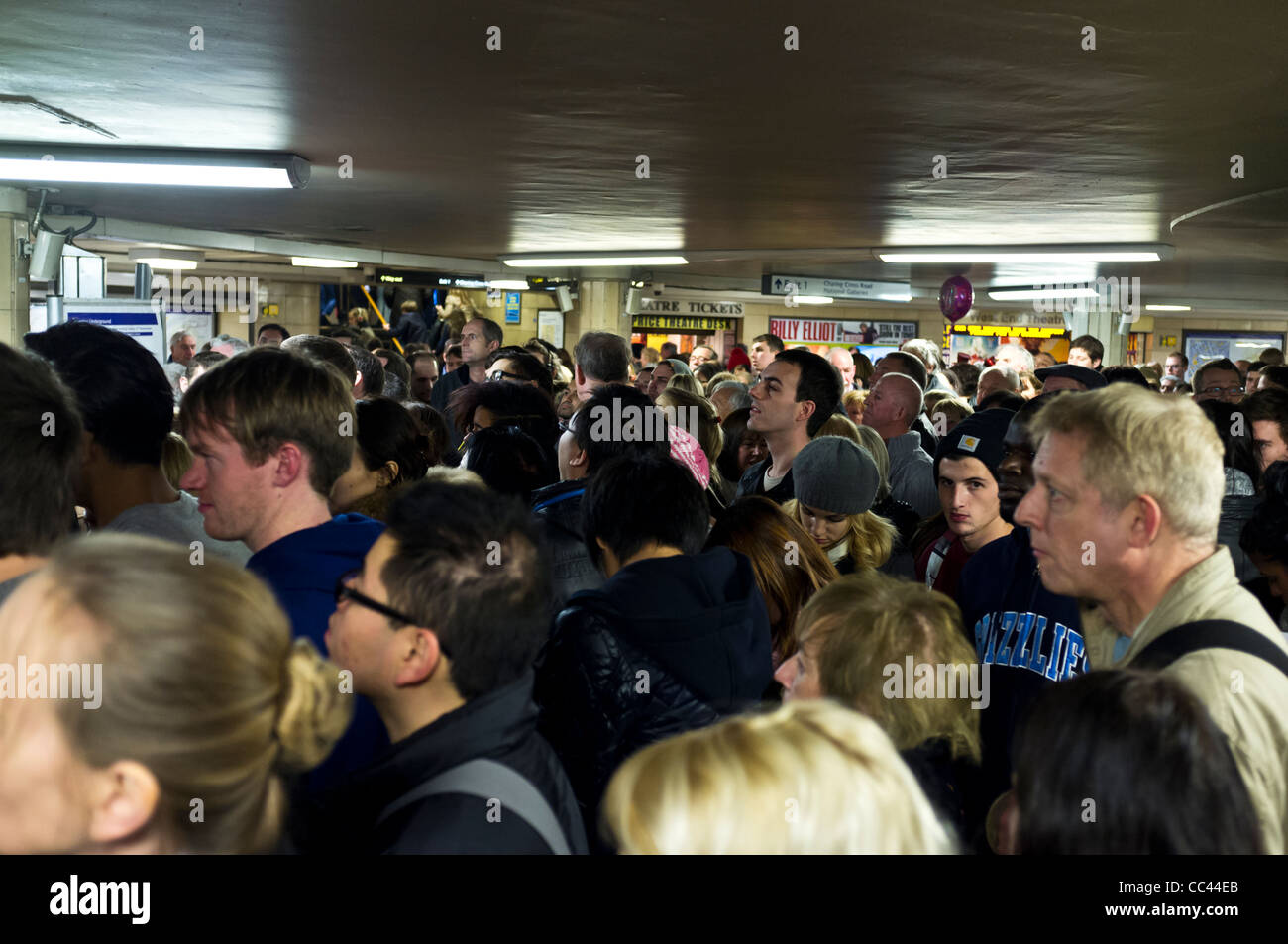 An overcrowded Leicester Square tube station. - Stock Image